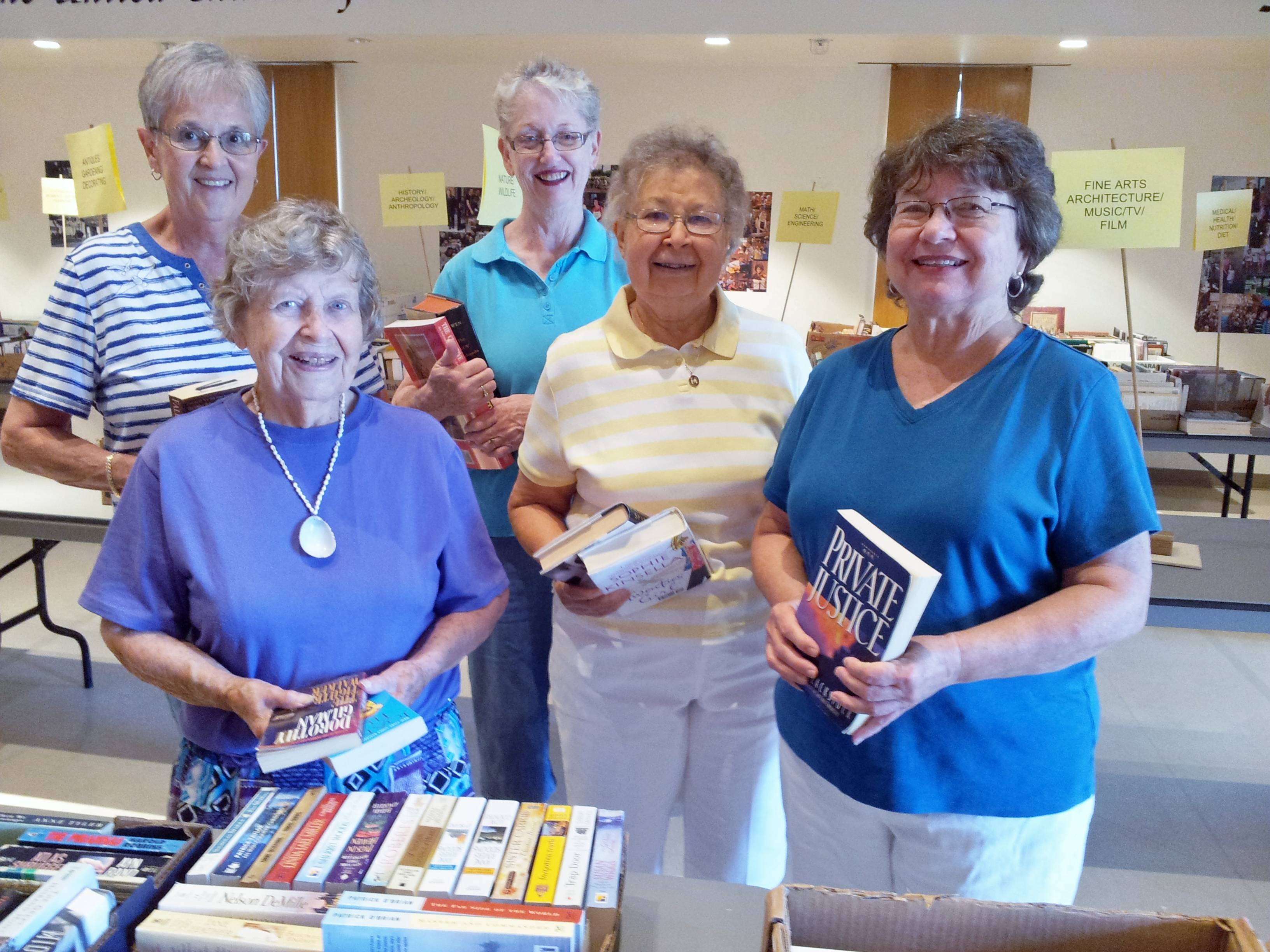 Members of the Lombard Area AAUW sort books at First Church of Lombard for our annual book sale. Back row - Carol Hester, Betsy Swinson; front row - Billie Jean Shapotkin, Mary Ann Grady, Lynda Campo