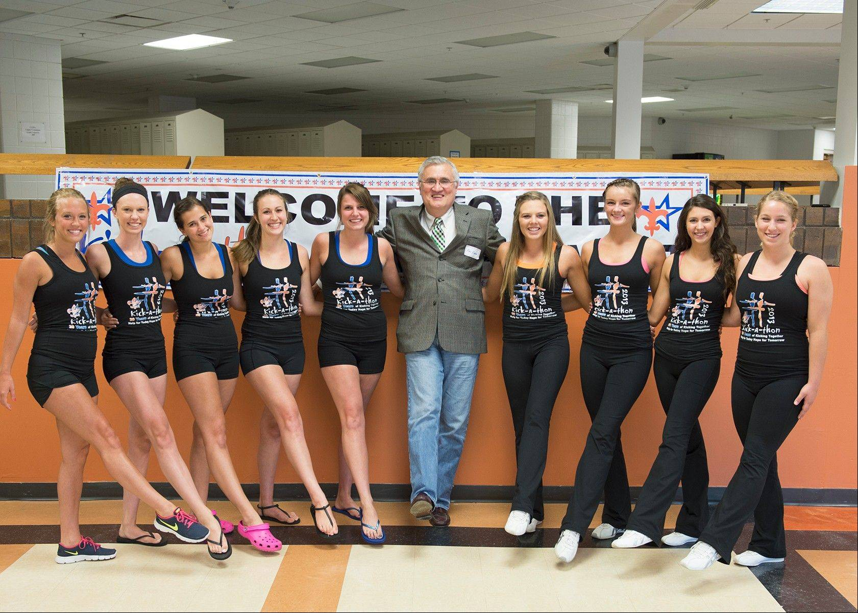 St. Charles Mayor Ray Rogina is joined by, from left, St. Charles North drill team seniors Alison Meisenheimer, Jamie Beaulieu, MaryKate Purcell, Kassidy Ams and Lexi Artman, and St. Charles East drill team seniors Tara Willing, Rhyleigh Keef, Rachael Manley and Maddie Culbertson.