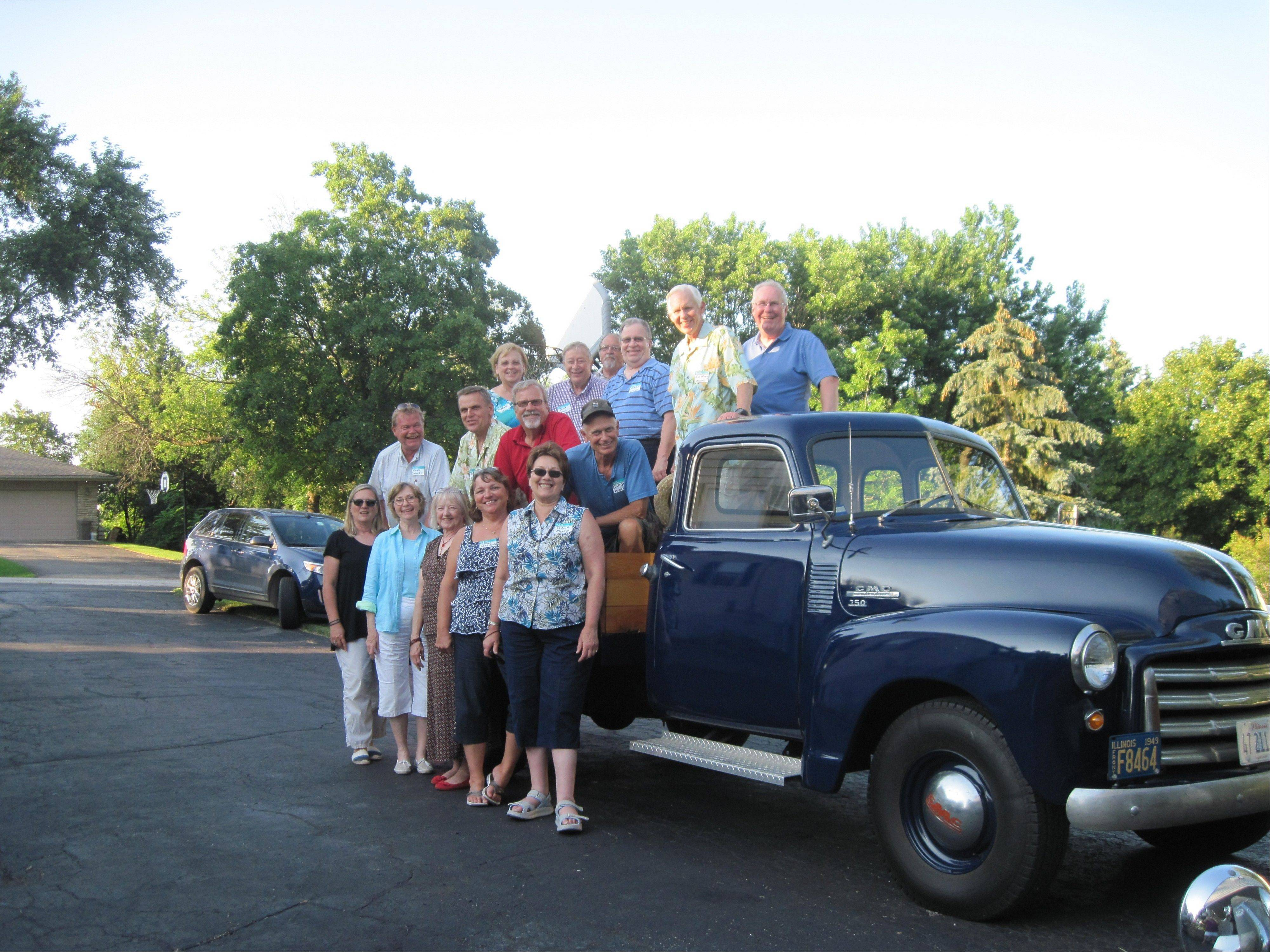 The Haemker Family pose at their family reunion with a 1949 GMC truck, which Chuck Anderson of Palatine restored.