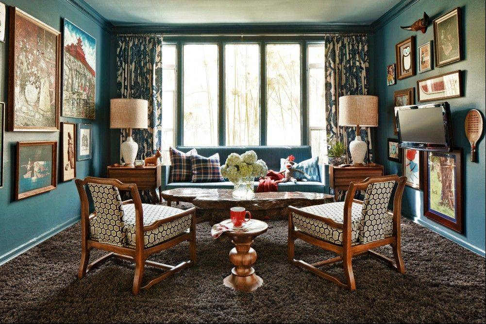Brian Patrick Flynn, who designed this living room, uses a colorful red, white and blue palette balanced by wood tones and muted browns to create a rich, layered look in this weekend home.