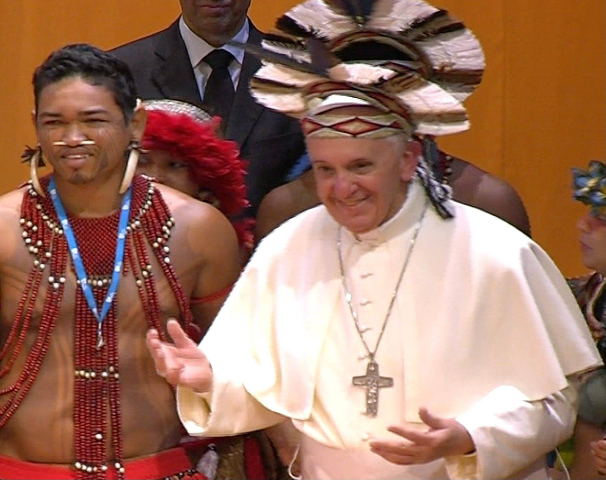 Associated Press In this frame grab from video Pope Francis wears an indigenous feather hat given to him by representatives of one of Brazil�s native tribes during a meeting at the Municipal Theater in Rio de Janeiro on Saturday, July 27. Pope Francis is on the sixth day of his trip to Brazil where he will attend the 2013 World Youth Day in Rio.