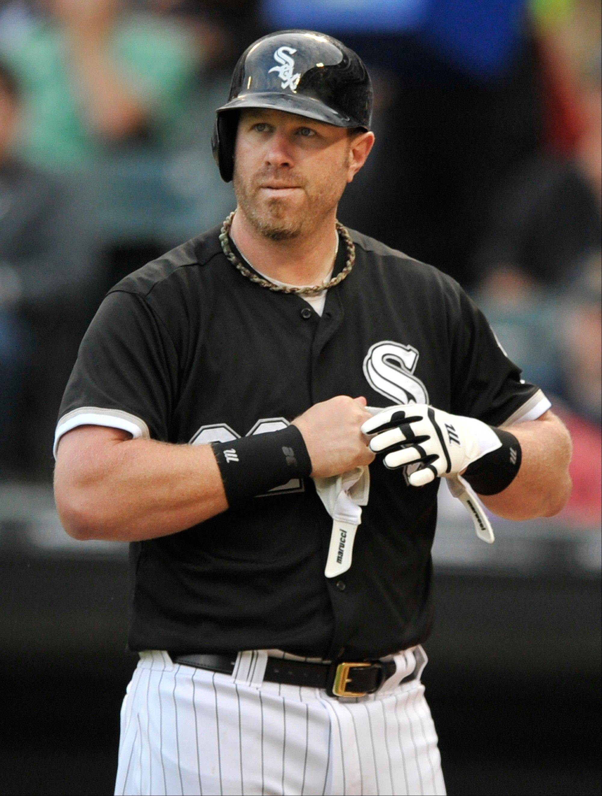 White Sox's Adam Dunn reacts after striking out during the first inning of a baseball game against the Kansas City Royals in Chicago, Saturday, July 27, 2013.