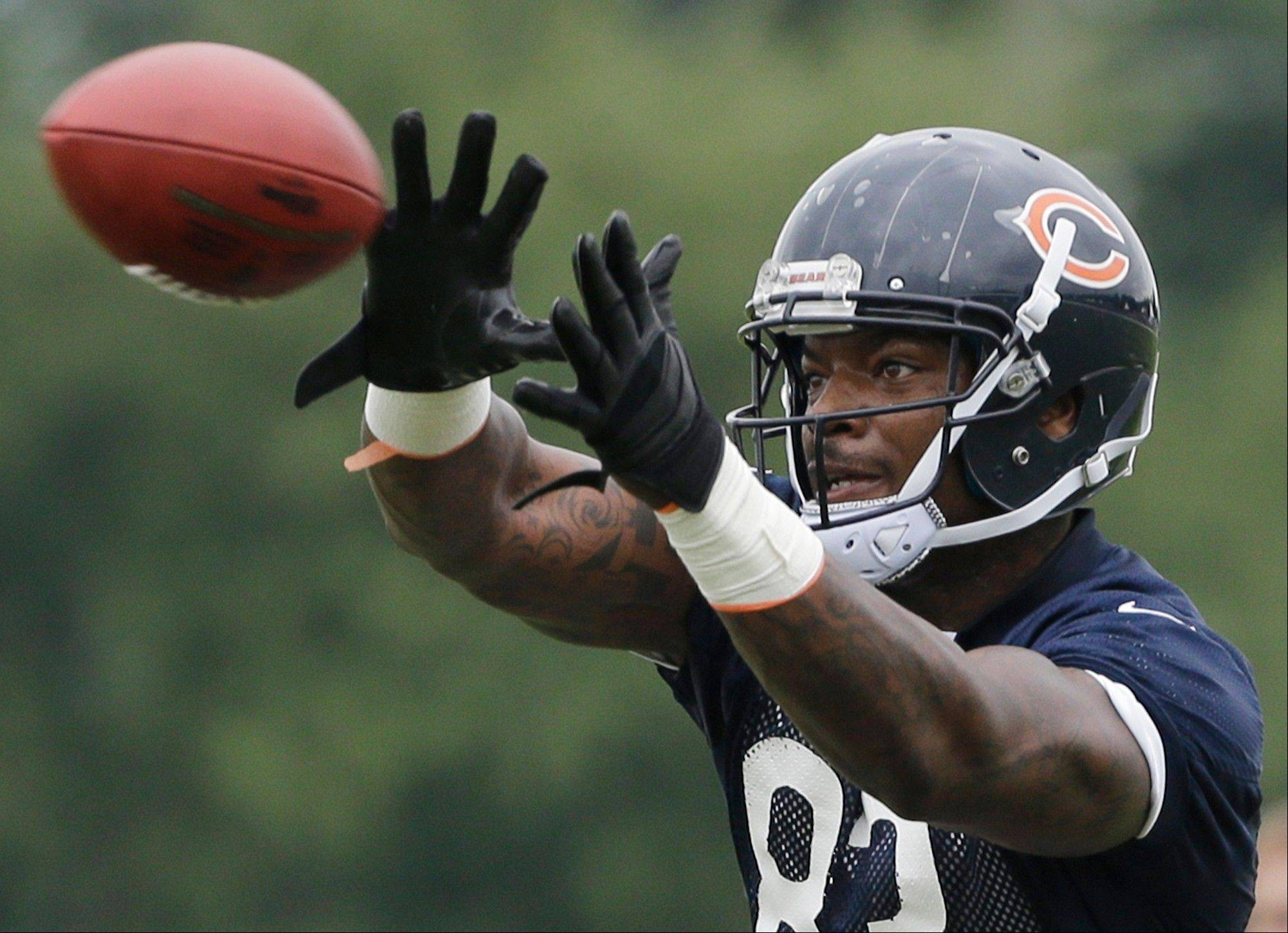 Martellus Bennett (83) catches a ball during NFL football training camp Saturday, July 27, 2013, at Olivet Nazarene University in Bourbonnais, Ill.