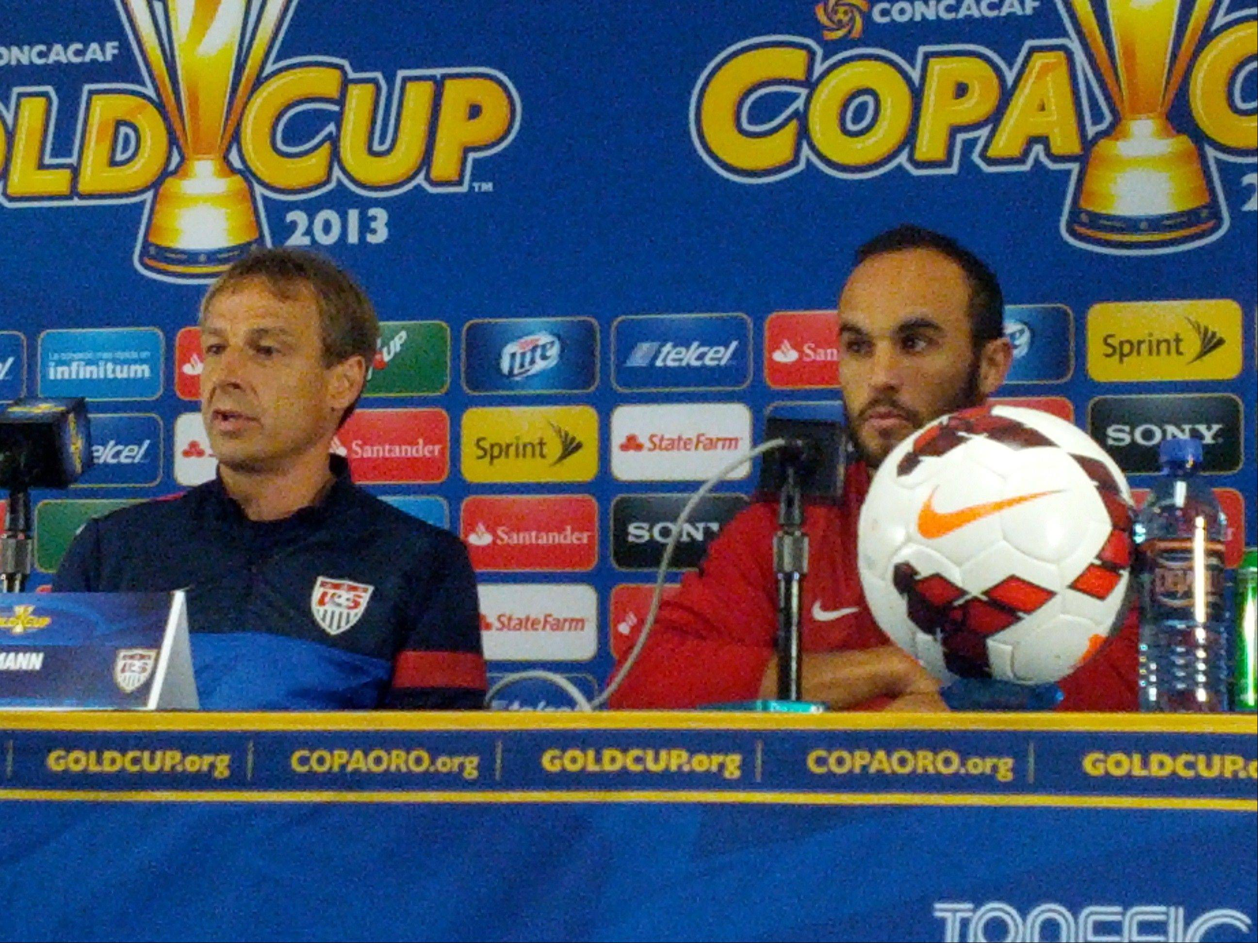 U.S. men's national team coach Jurgen Klinsmann, left, and forward/midfielder Landon Donovan meet the media Saturday afternoon at Soldier Field ahead of Sunday's Gold Cup final in Chicago.