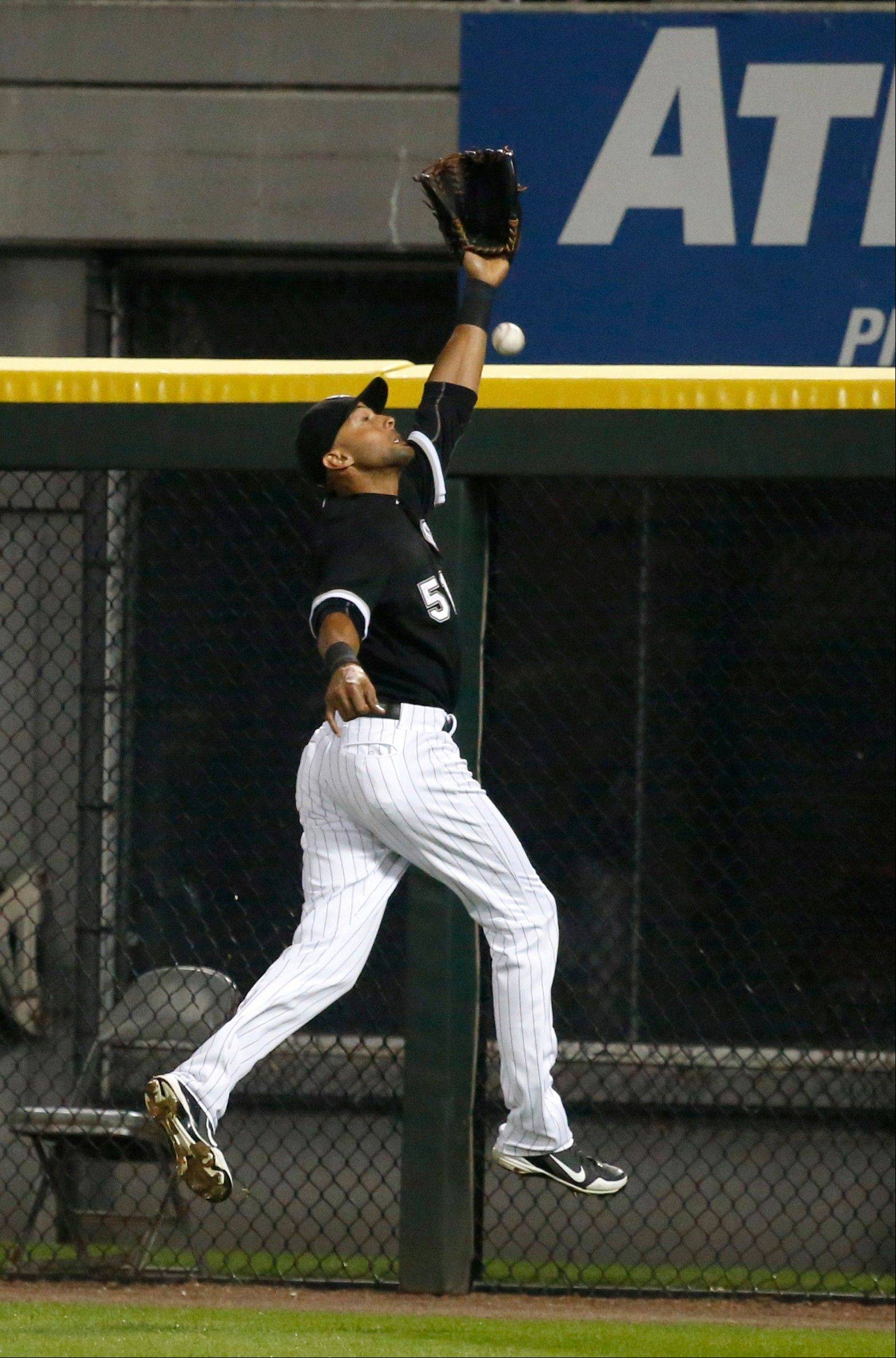 Chicago White Sox right fielder Alex Rios is unable to catch a long fly ball, scoring Salvador Perez, off the bat of Kansas City Royals� Mike Moustakas during the ninth inning of a baseball game on Friday, July 26, 2013, in Chicago. (AP Photo/Charles Rex Arbogast)