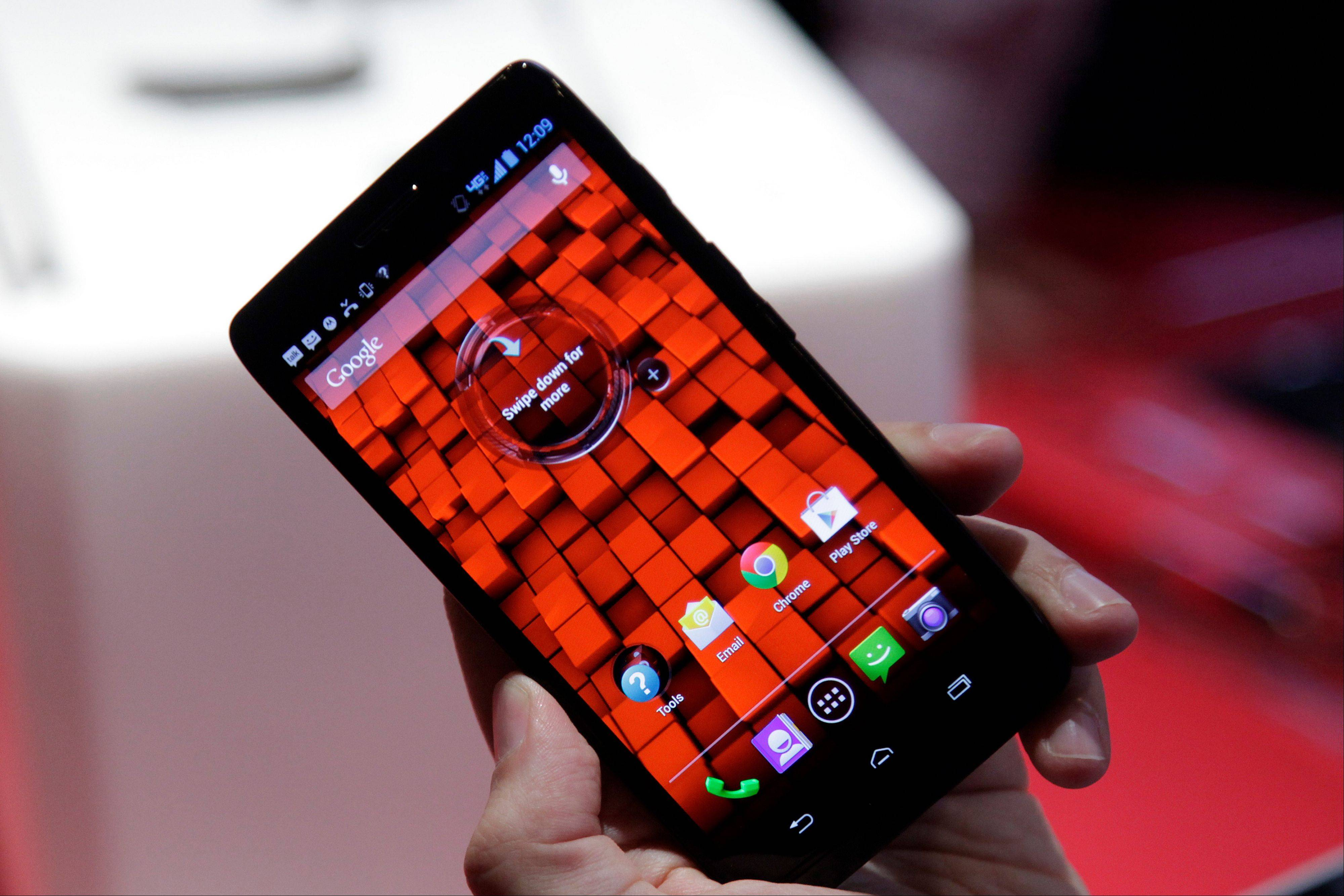 The Motorola Droid Ultra, offered by Verizon, is unveiled, Tuesday, July 23, 2013 in New York. The 5-inch smartphone has a Kevlar shell that makes it thinner and stronger and it is equipped with a dual-core X8 Mobile Computing System.