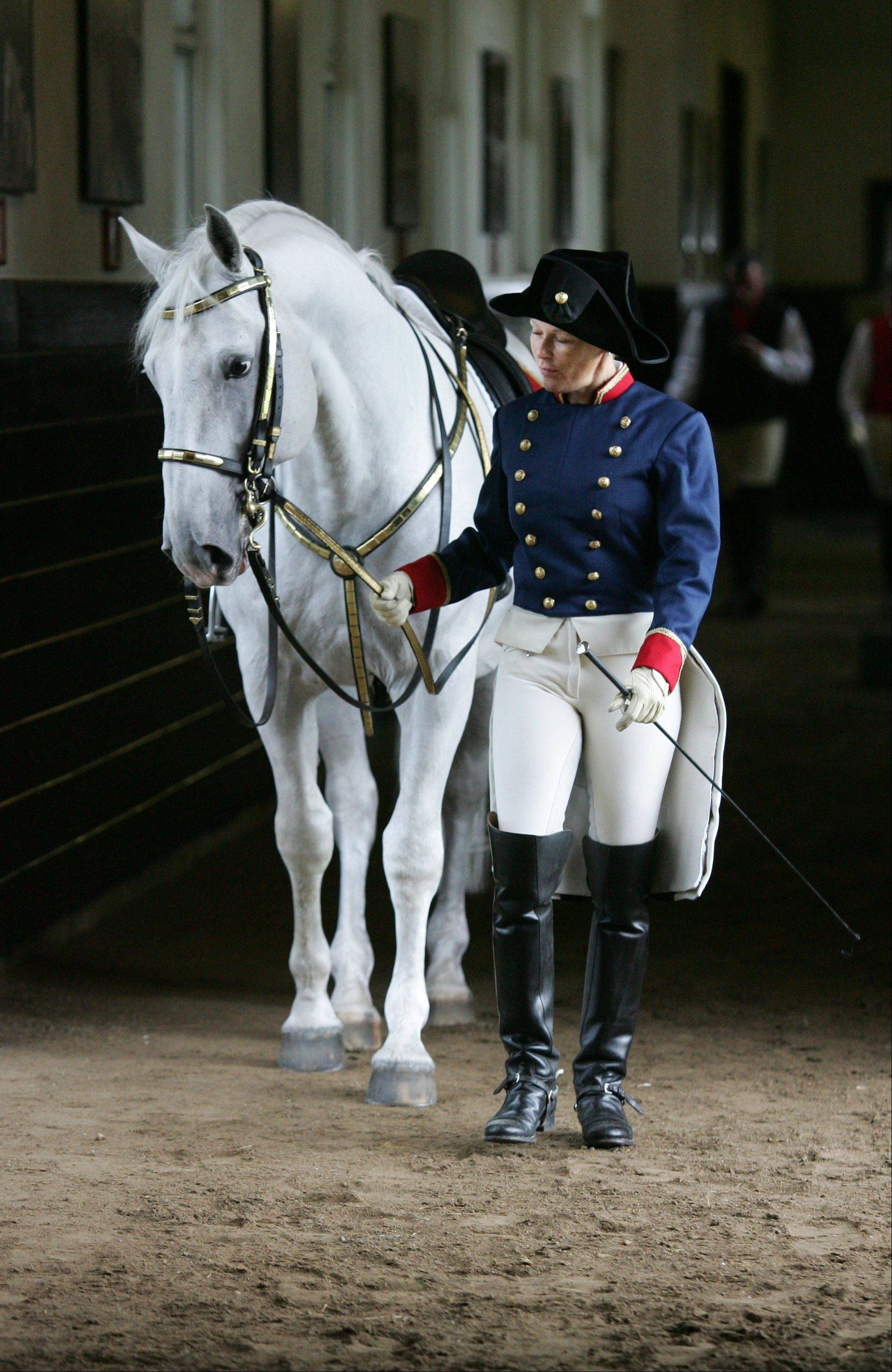 Linda Leffingwell walks with Neapolitano VI Anita as part of the Tempel Lipizzan show.