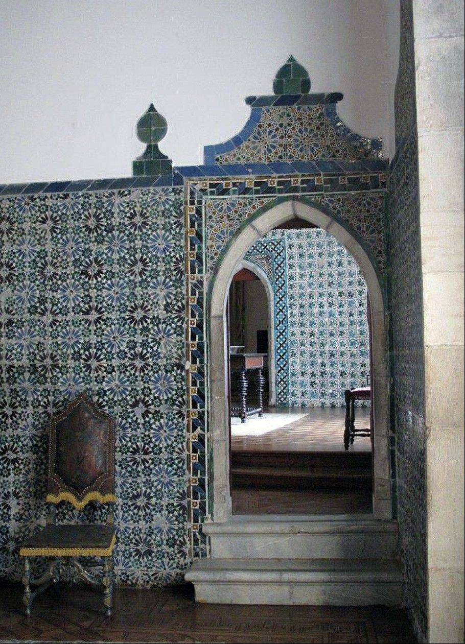 Tiled walls and arched doorways inside the Monserrate Palace in Sintra, Portugal. The palace is one of a number of castles and other spectacular buildings found in Sintra, which has long been a playground of royalty near the Portuguese capital of Lisbon.
