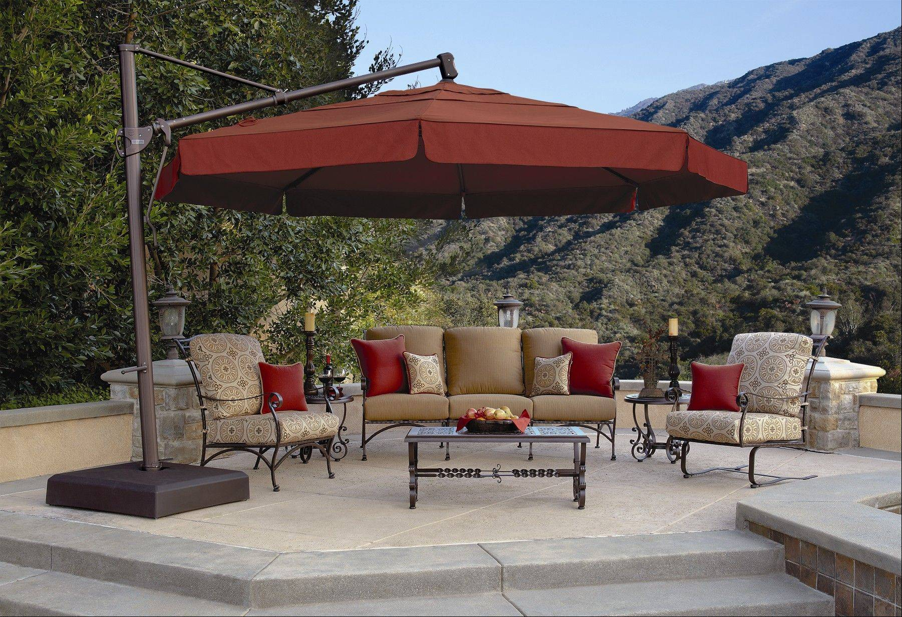 "Today's patio umbrella is free-standing and rotates to cover more ""real estate."""