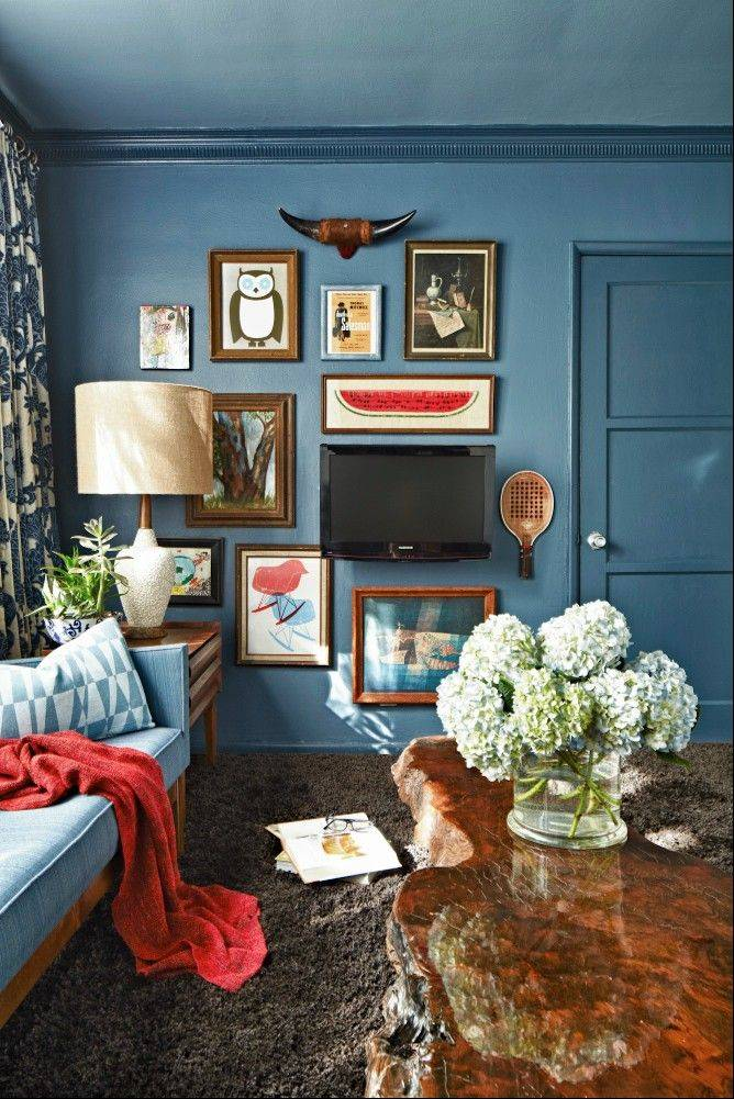 Designer Brian Patrick Flynn shows found art bought second hand at flea markets for the walls of his Southern California weekend home. The whimsical mix of paintings and prints provides a perfect spot to hide a flat-screen television.