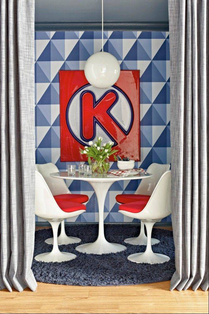 Flynn says the Circle K sign in his tiny breakfast nook was found at a flea market, and provides a sentimental connection to his teen years.