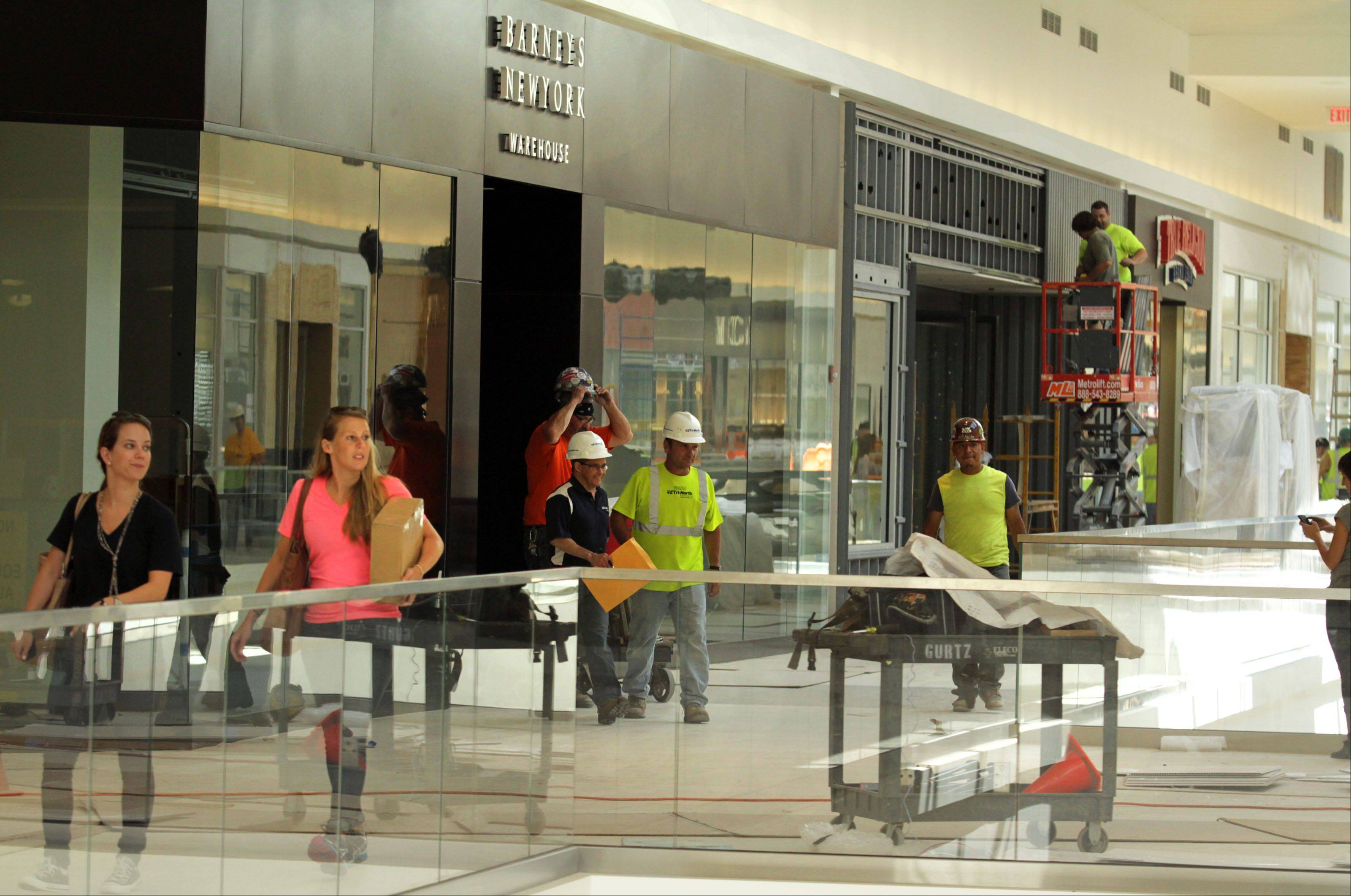 Workers at Fashion Outlets of Chicago in Rosemont on Wednesday, July 24, 2013.