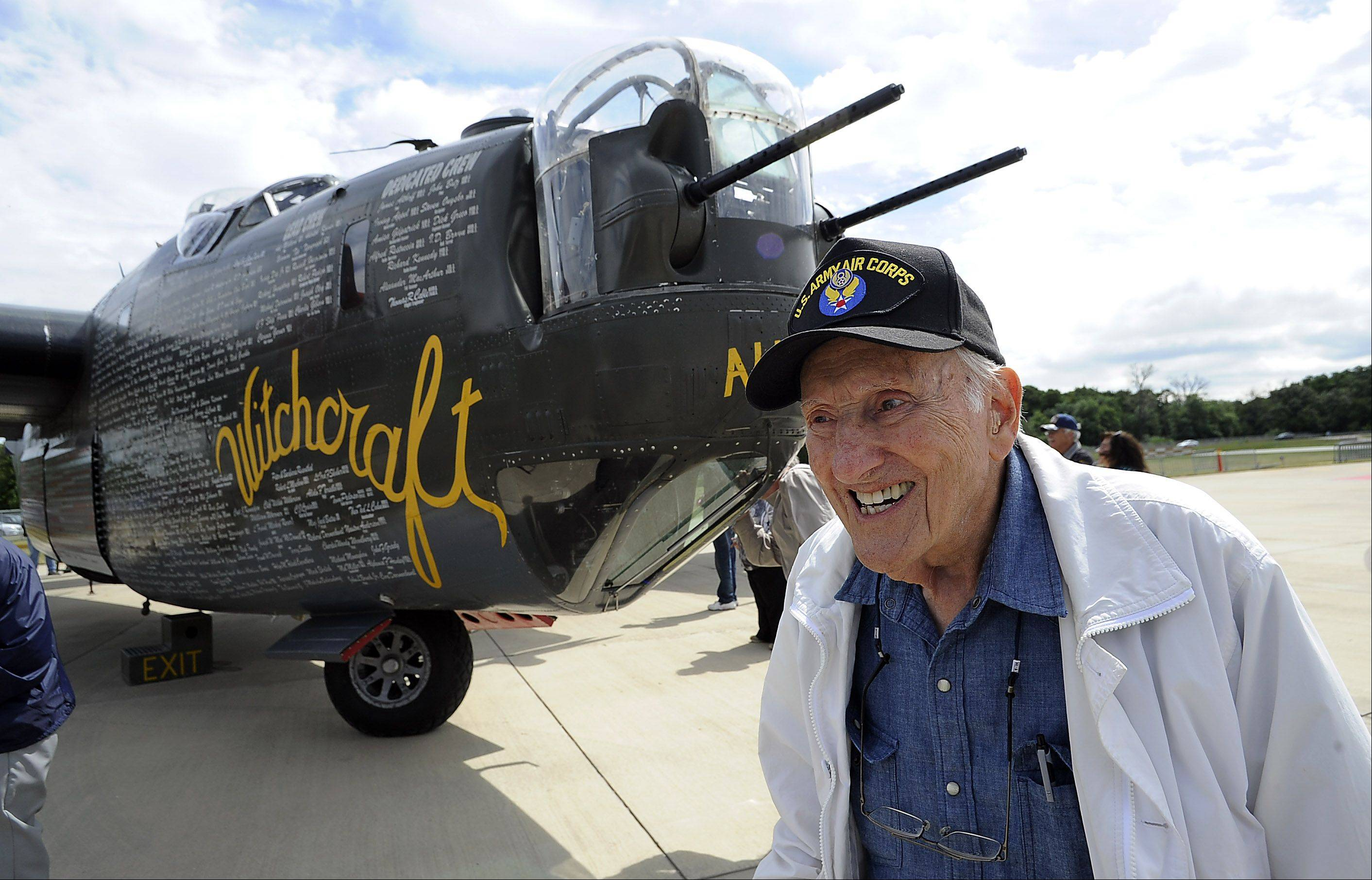 Jim Brahos, 90, of Beach Park, Illinois smiles fondly as he stands by the B-24 Liberator, just like the one he was a tailgunner in during World War II serving the years 1942 through 1945 at Chicago Executive Airport on Saturday.