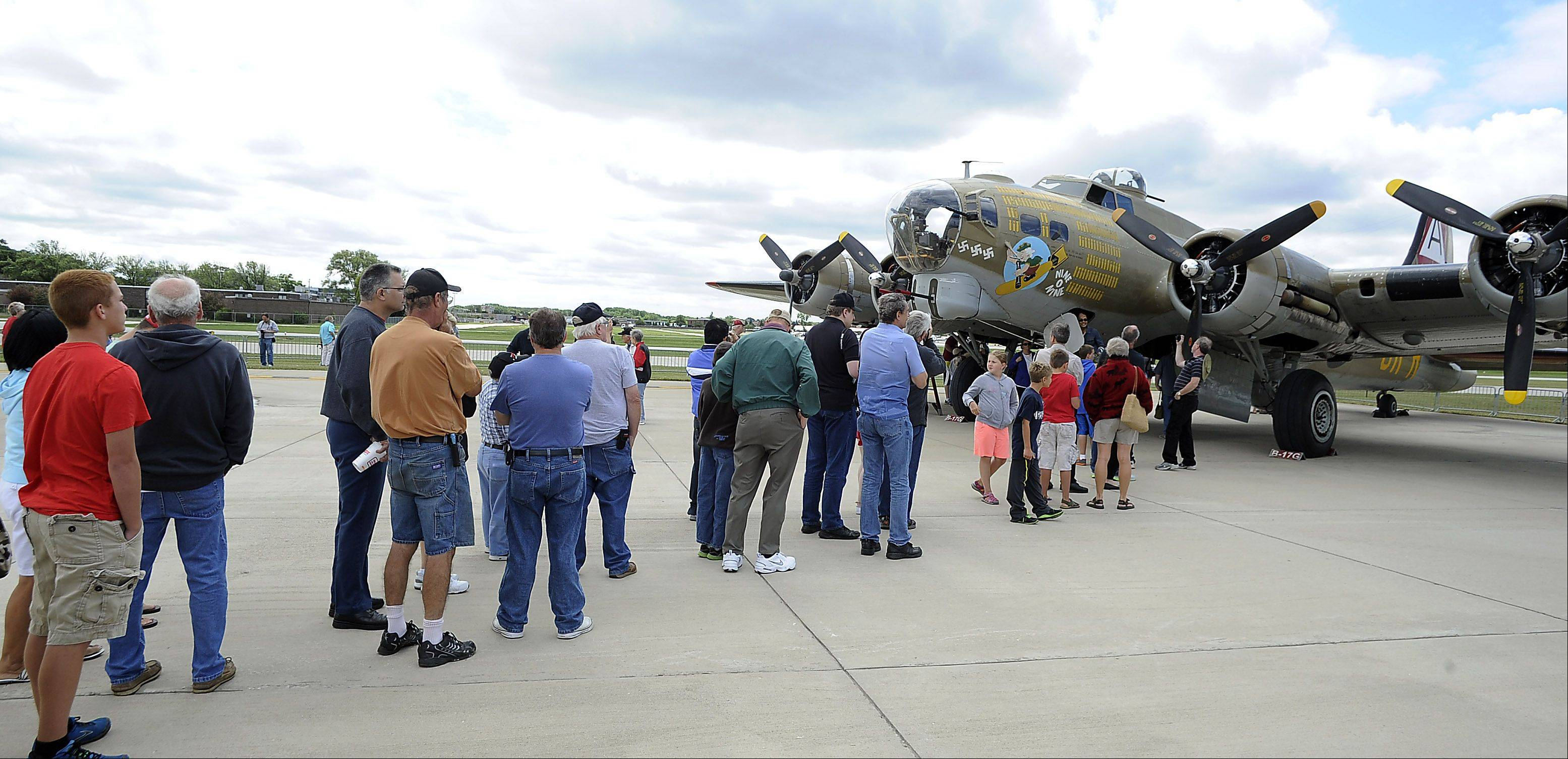 Long lines of people wait to check out the B-17 Flying Fortress which landed at Chicago Executive Airport on Saturday as part of the 2013 Wings of Freedom Tour.