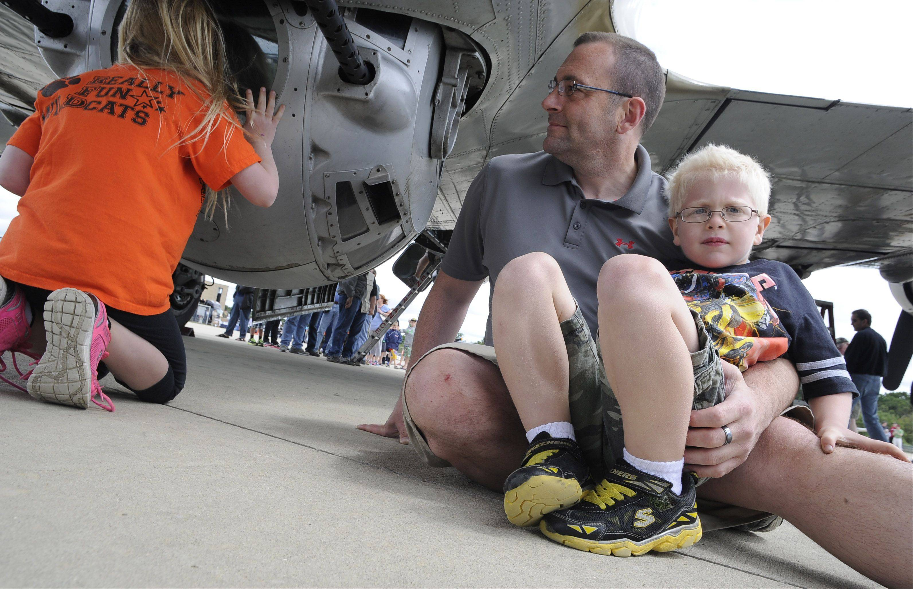 Mina Walldorf, 7, of Libertyville along with her dad Karl and brother Erich, 5 , check out the B-17 Flying Fortress which landed at Chicago Executive Airport on Saturday as part of the 2013 Wings of Freedom Tour.