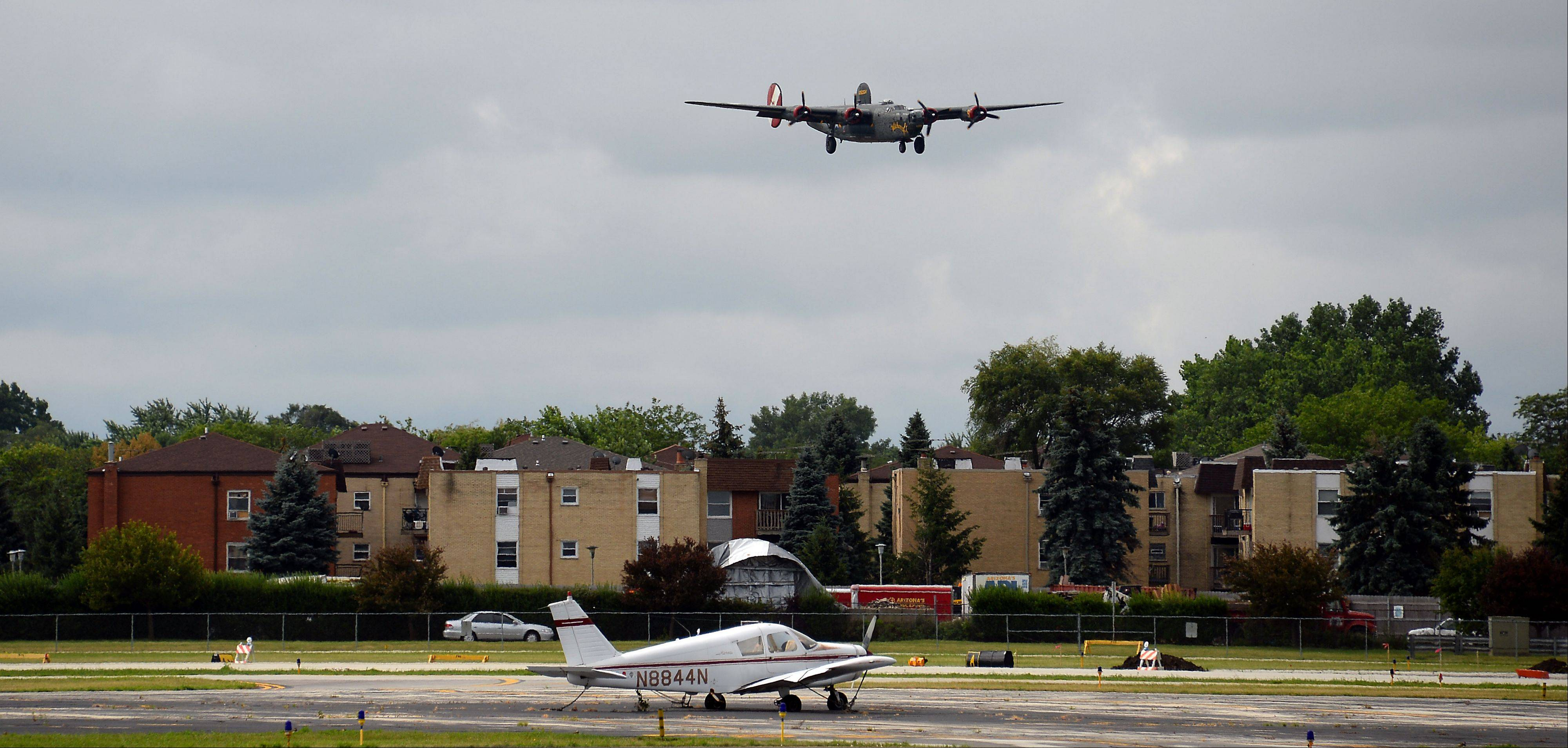 The B-24 Liberator lands at Chicago Executive Airport on Saturday as part of the 2013 Wings of Freedom Tour.