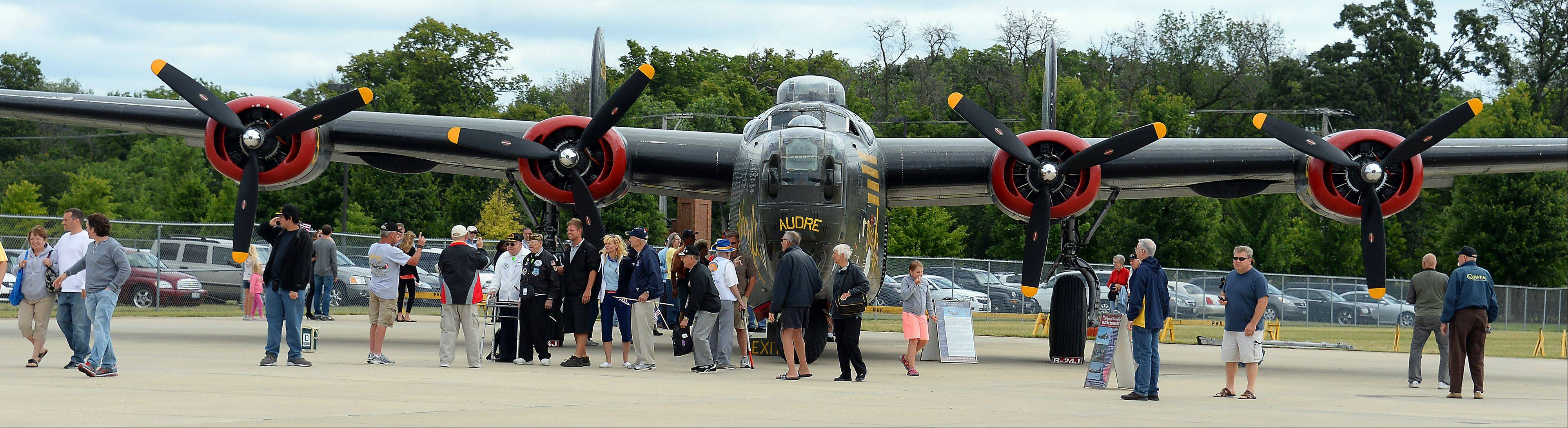 Long lines of people wait to check out the B-24 Liberator which landed at Chicago Executive Airport on Saturday as part of the 2013 Wings of Freedom Tour.