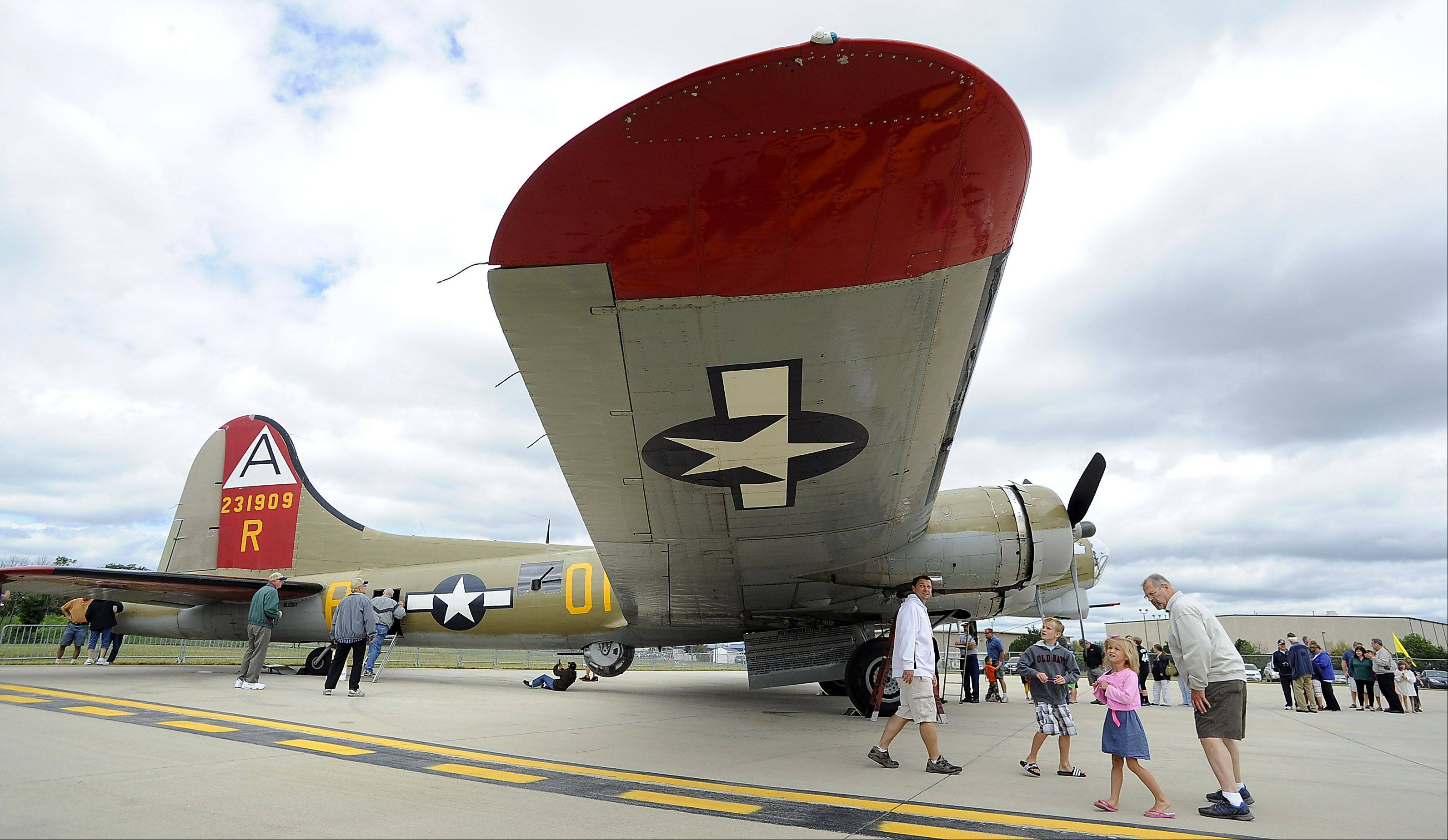 Allan Karg along with Jason Karg and his kids, Drew, 8 , and Ava, 5 , of Aurora check out the B-17 Flying Fortress which landed at Chicago Executive Airport on Saturday as part of the 2013 Wings of Freedom Tour.