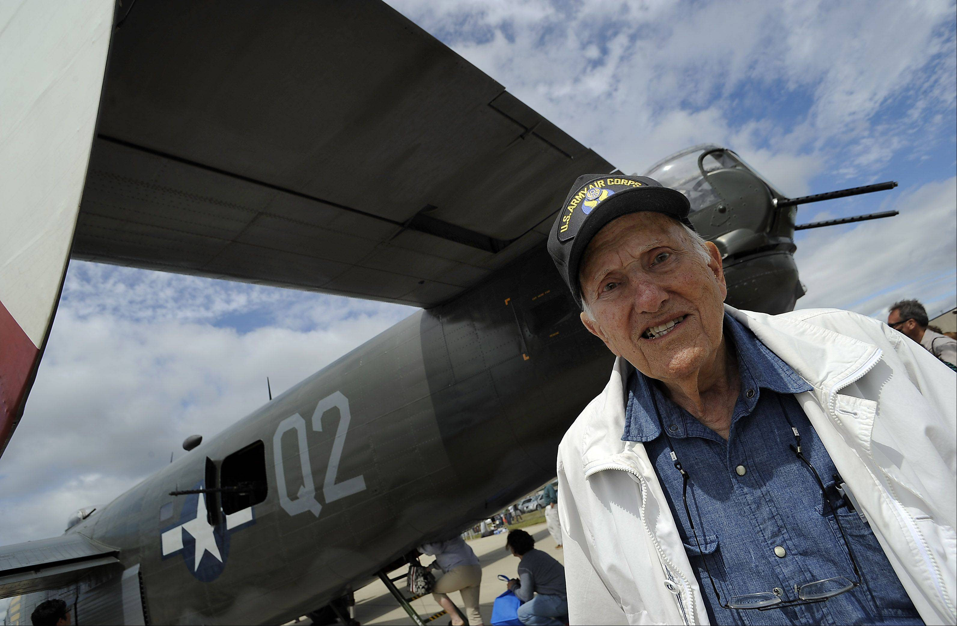 Jim Brahos, 90, of Beach Park, Illinois stands by the tailgunner section of the B-24 Liberator, just like the one he was a tailgunner in during World War II serving the years 1942 through 1945 at Chicago Executive Airport on Saturday.