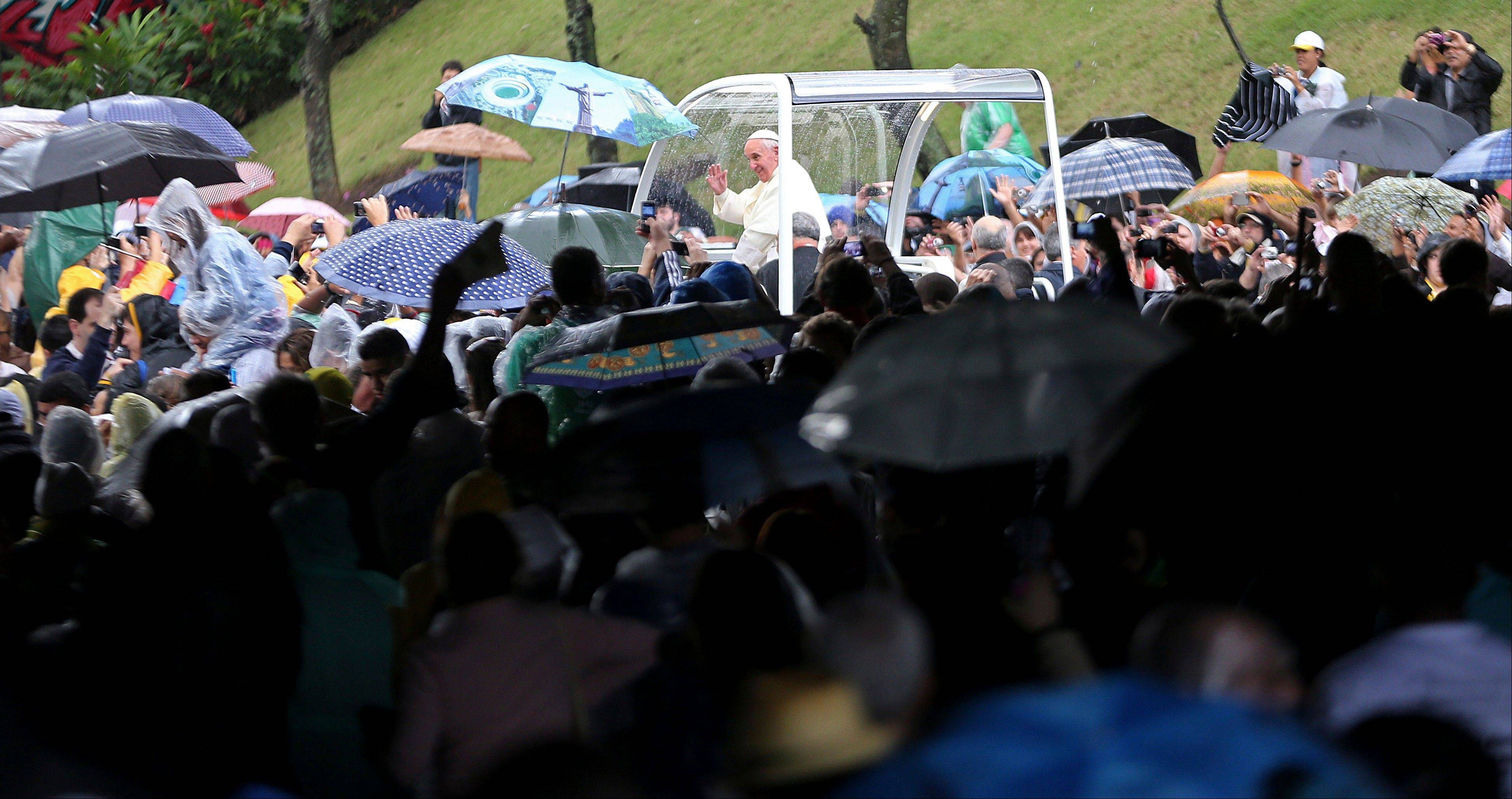 Associated PressPope Francis waves to people from his popemobile in Rio de Janeiro on Saturday, July 27. Pope Francis on Saturday challenged bishops from around the world to get out of their churches and preach, and to have the courage to go to the farthest margins of society to find the faithful.
