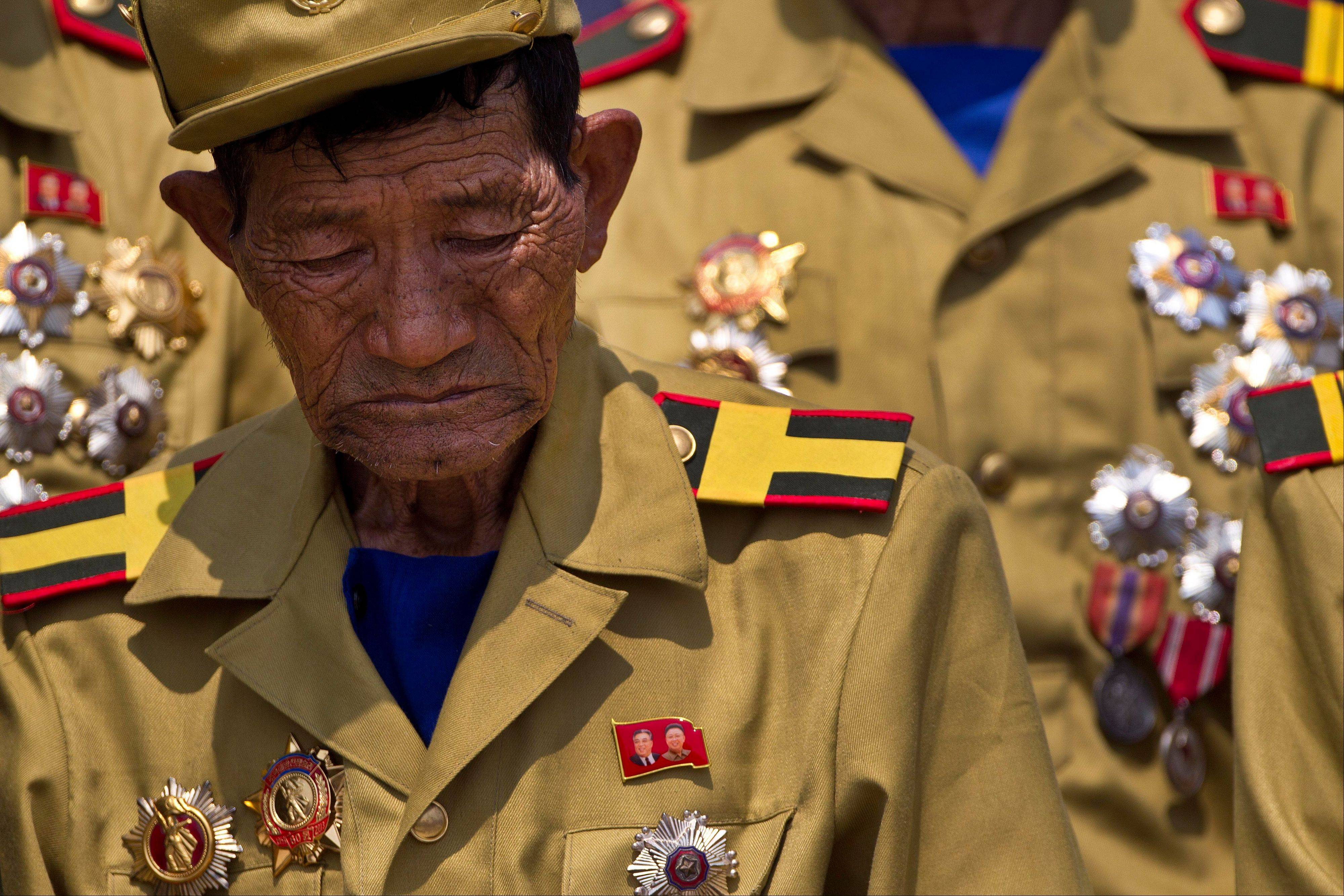 Associated PressA North Korean veteran of the Korean War bows his head during a mass military parade on Kim Il Sung Square in Pyongyang to mark the 60th anniversary of the Korean War armistice, Saturday, July 27.