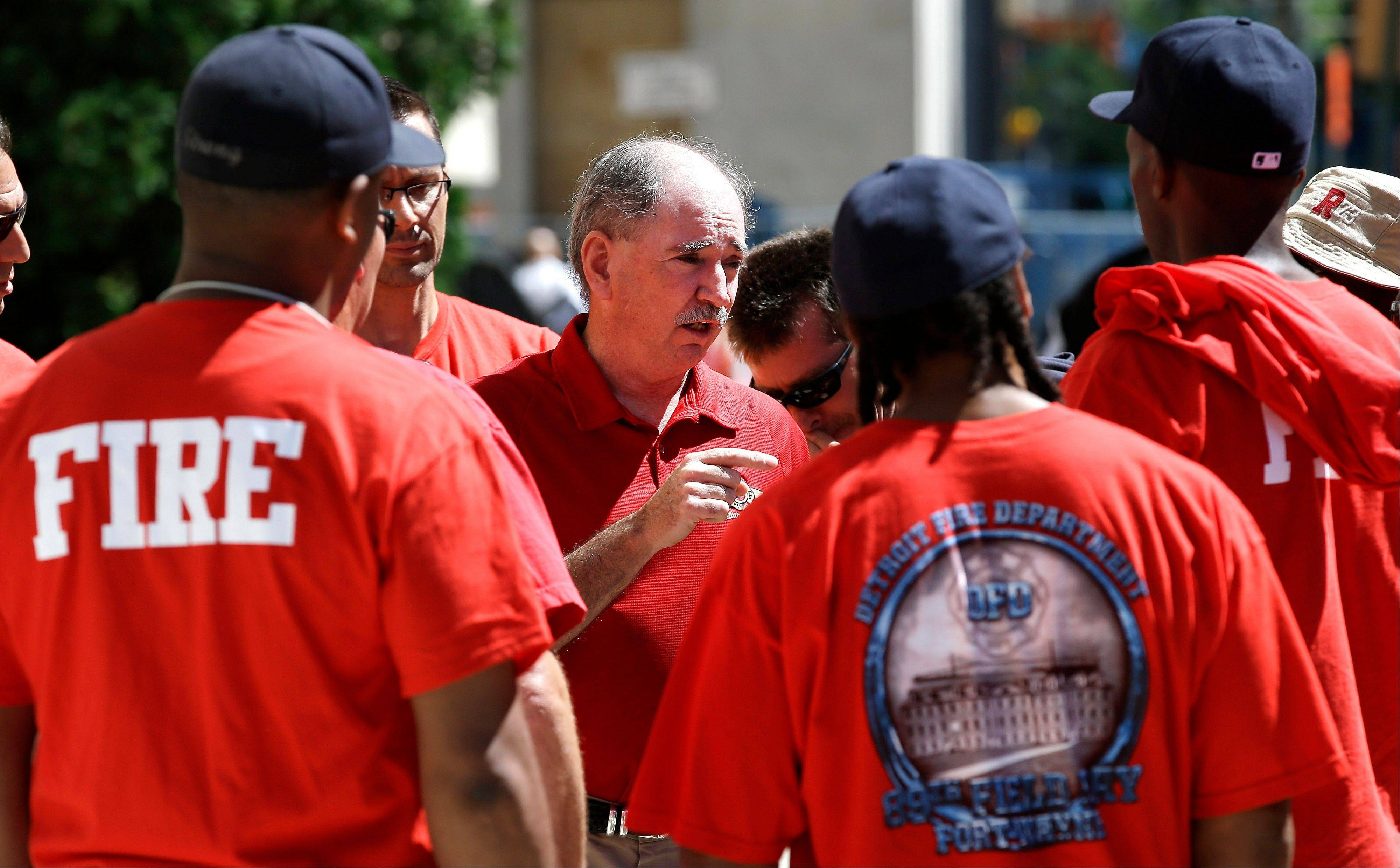 On July 24 Dan McNamara, president of the Detroit Fire Fighters Association, speaks to firefighters outside the Theodore Levin United States Courthouse in Detroit. Detroit's historic bankruptcy filing is a major setback for public sector unions that have spent years trying to ward off cuts to the pensions and benefits of government workers. If the city succeeds, it could put into jeopardy a key bargaining tool for unions that have often deferred higher wages in favor of more generous pension benefits. And it could embolden other financially troubled cities dealing with pension shortfalls to consider bankruptcy, or at least take a harder line with their unions in negotiating cuts.