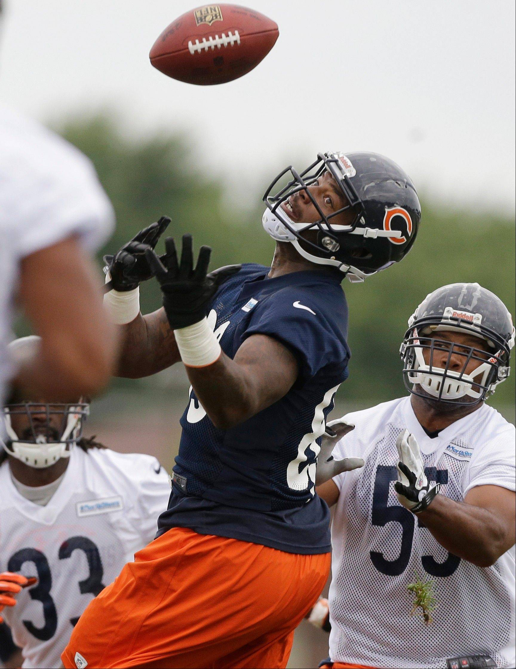 Chicago Bears tight end Martellus Bennett (83) tries to catch a ball during NFL football training camp Friday, July 26, 2013, at Olivet Nazarene University in Bourbonnais, Ill.