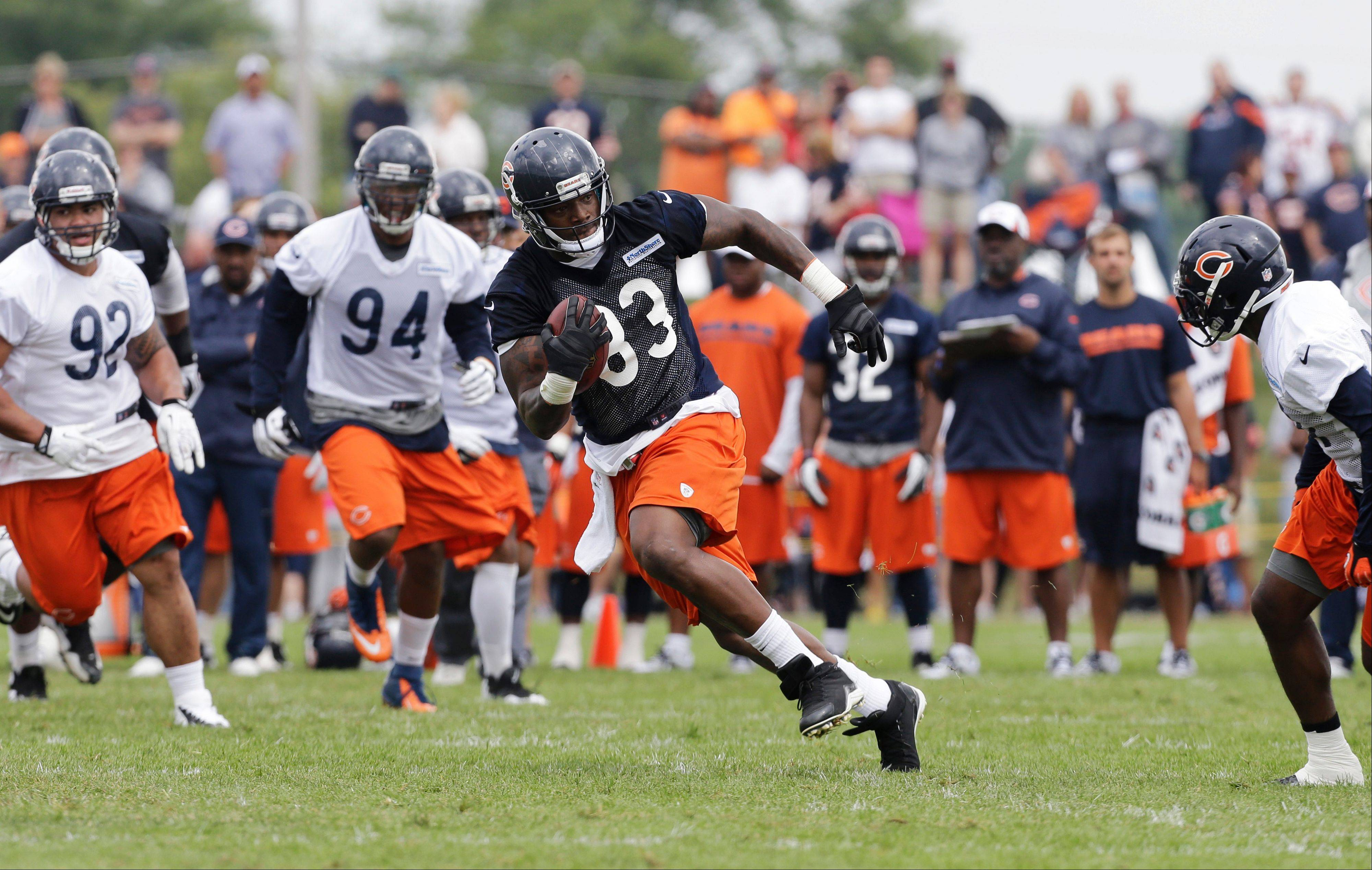 Chicago Bears tight end Martellus Bennett (83) runs with a ball during NFL football training camp Saturday, July 27, 2013, at Olivet Nazarene University in Bourbonnais, Ill.
