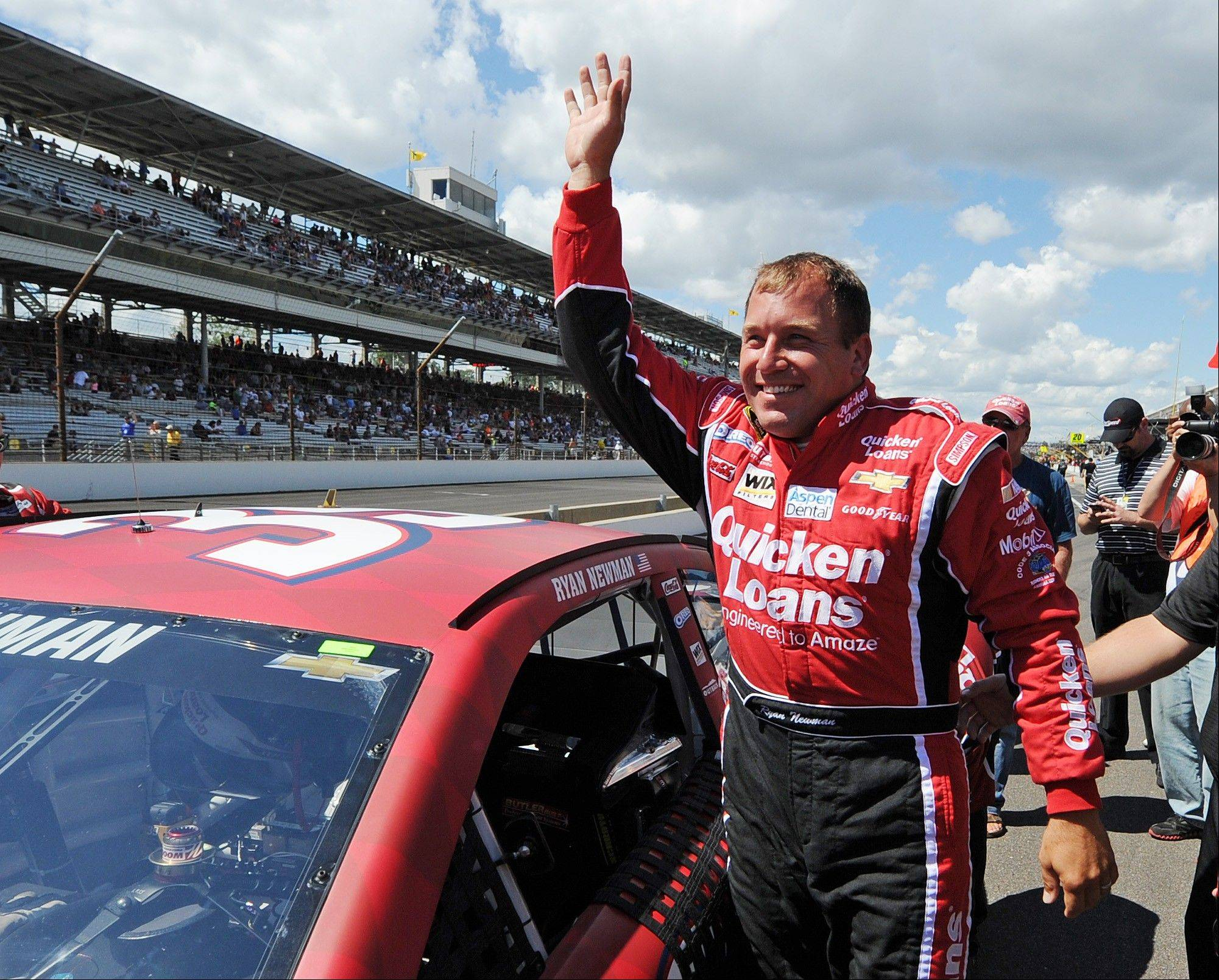 Sprint Cup Series driver Ryan Newman waves to the fans after qualifying for the pole position for the Brickyard 400 auto race at the Indianapolis Motor Speedway in Indianapolis, Saturday,July 27, 2013. Newman qualified with a speed of 187.531 mph.