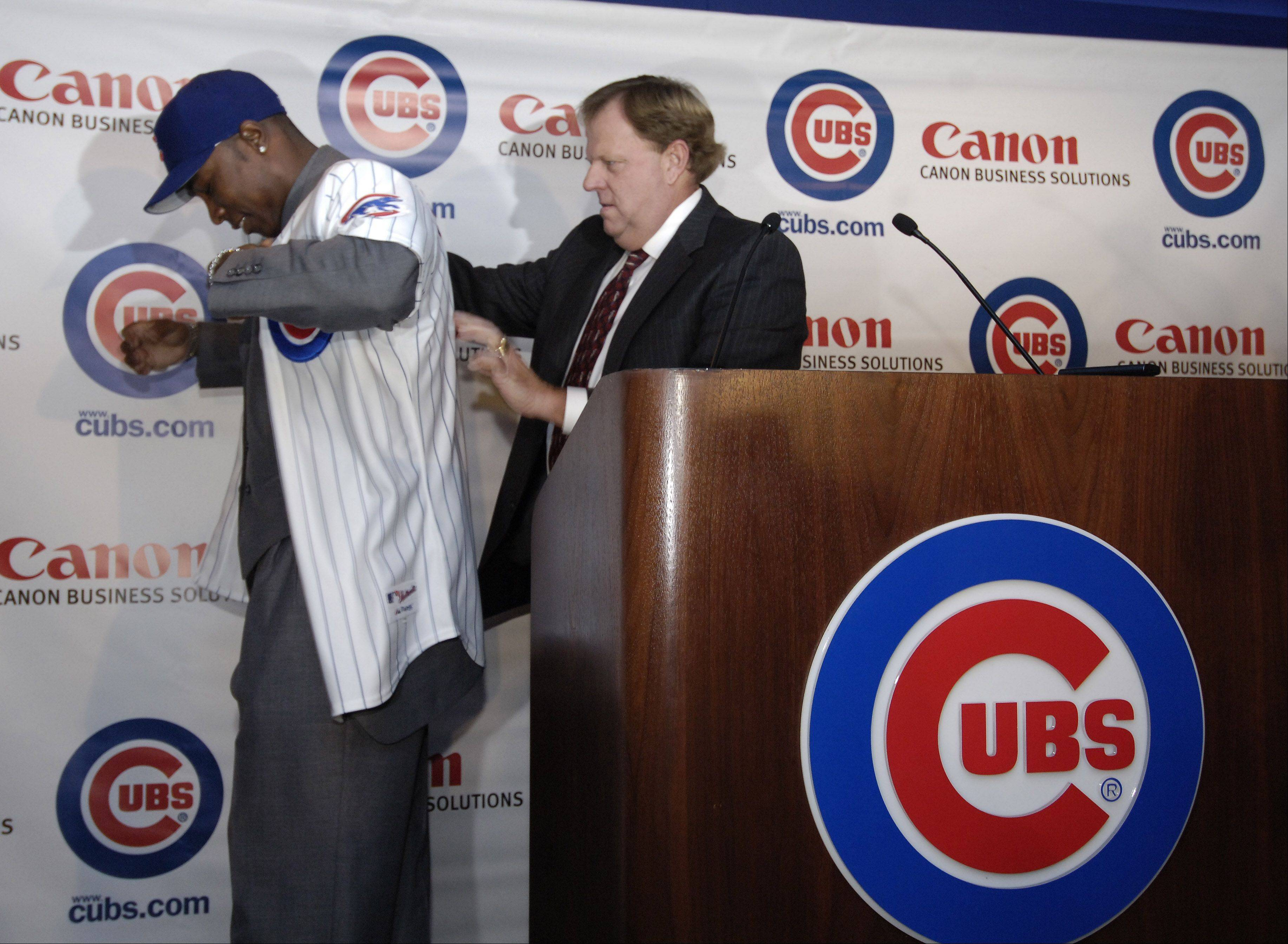 Cubs outfielder Alfonso Soriano got somehelp with his jersey from general manager Jim Hendry after he signed with the Cubs.