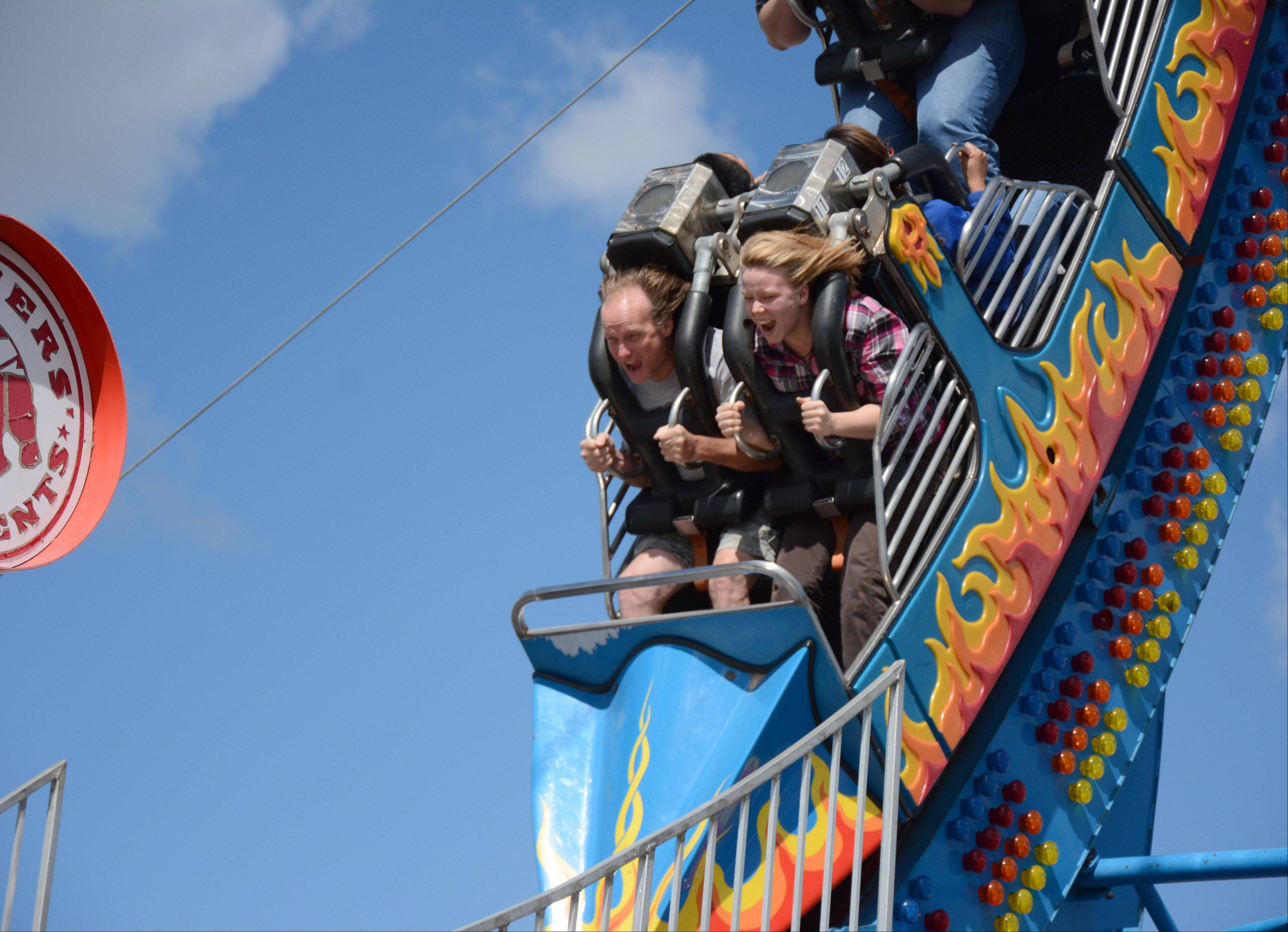 Bob Ellison, of Fox Lake, rides the Fireball with daughter Amanda at the Lake County Fair Sunday, July 28.