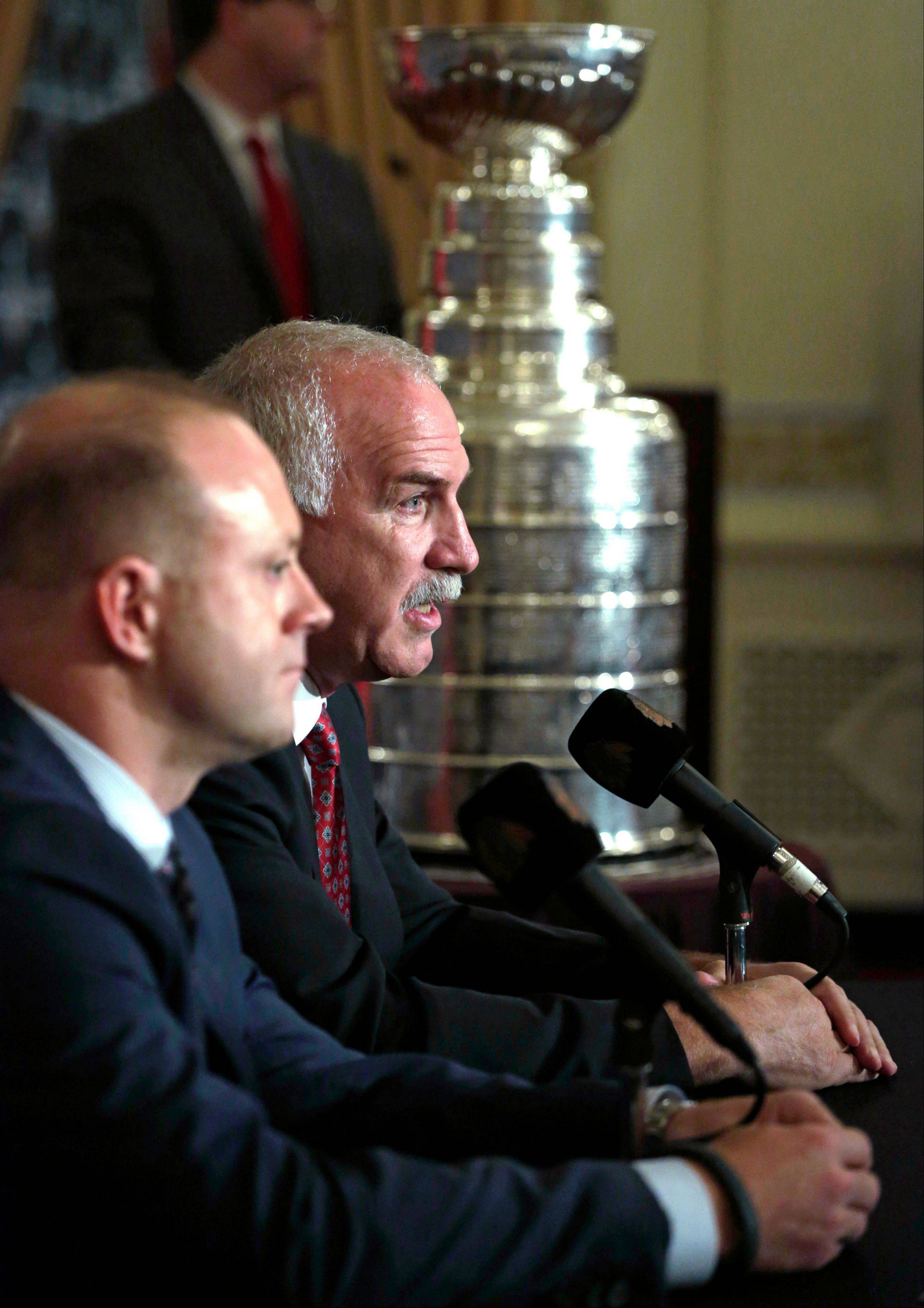 Blackhawks coach Joel Quenneville, right, and general manager Stan Bowman appear at a news conference during the sixth annual Blackhawks Convention.