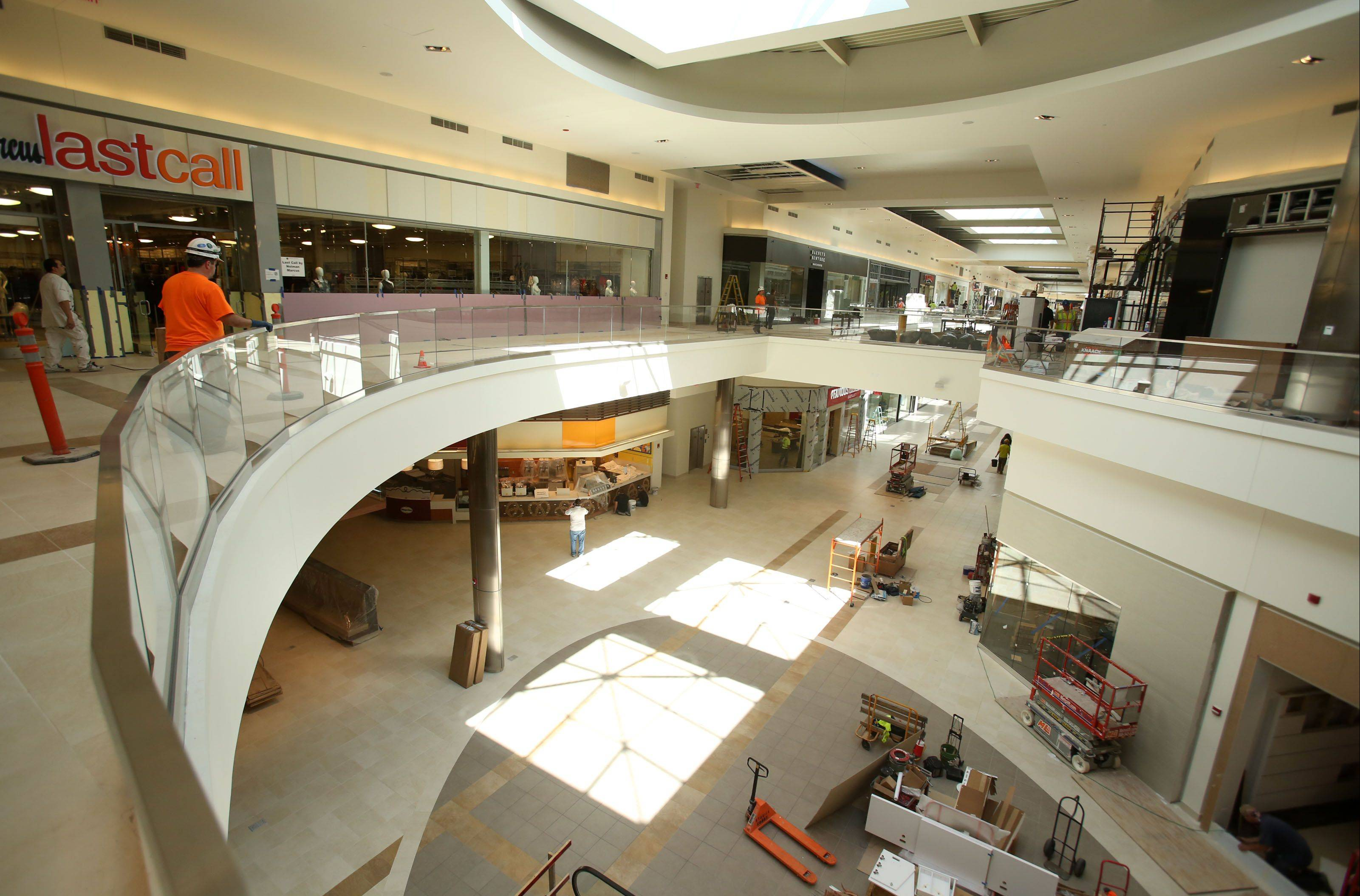 Workers put finishing touches on the inside of Fashion Outlets of Chicago in Rosemont ahead of its opening Thursday. Aug. 1.