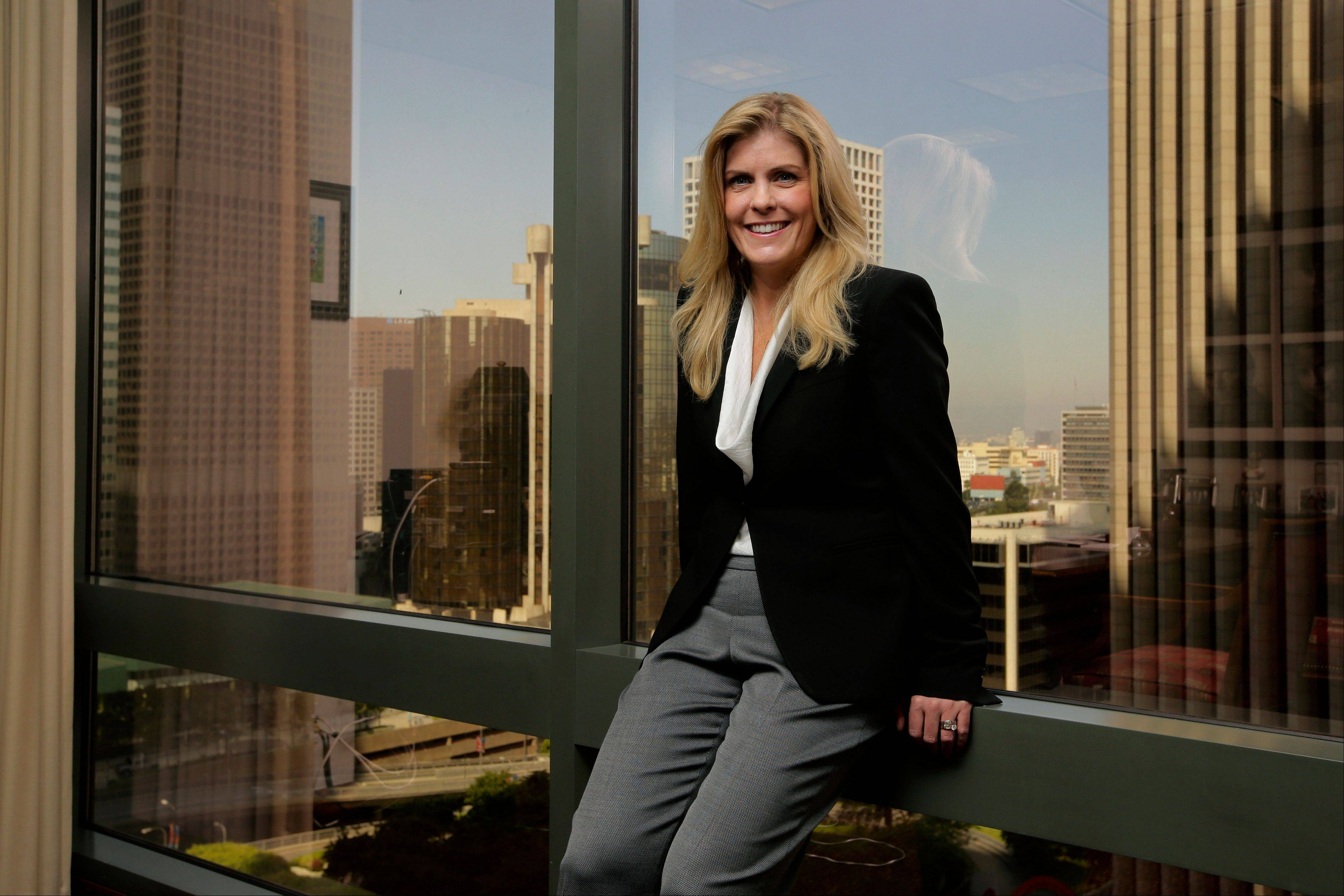 Lisa Stevens, a regional banking executive of Wells Fargo, poses for a photo in her office in Los Angeles. Wells Fargo is one of the country's biggest lenders to small business.