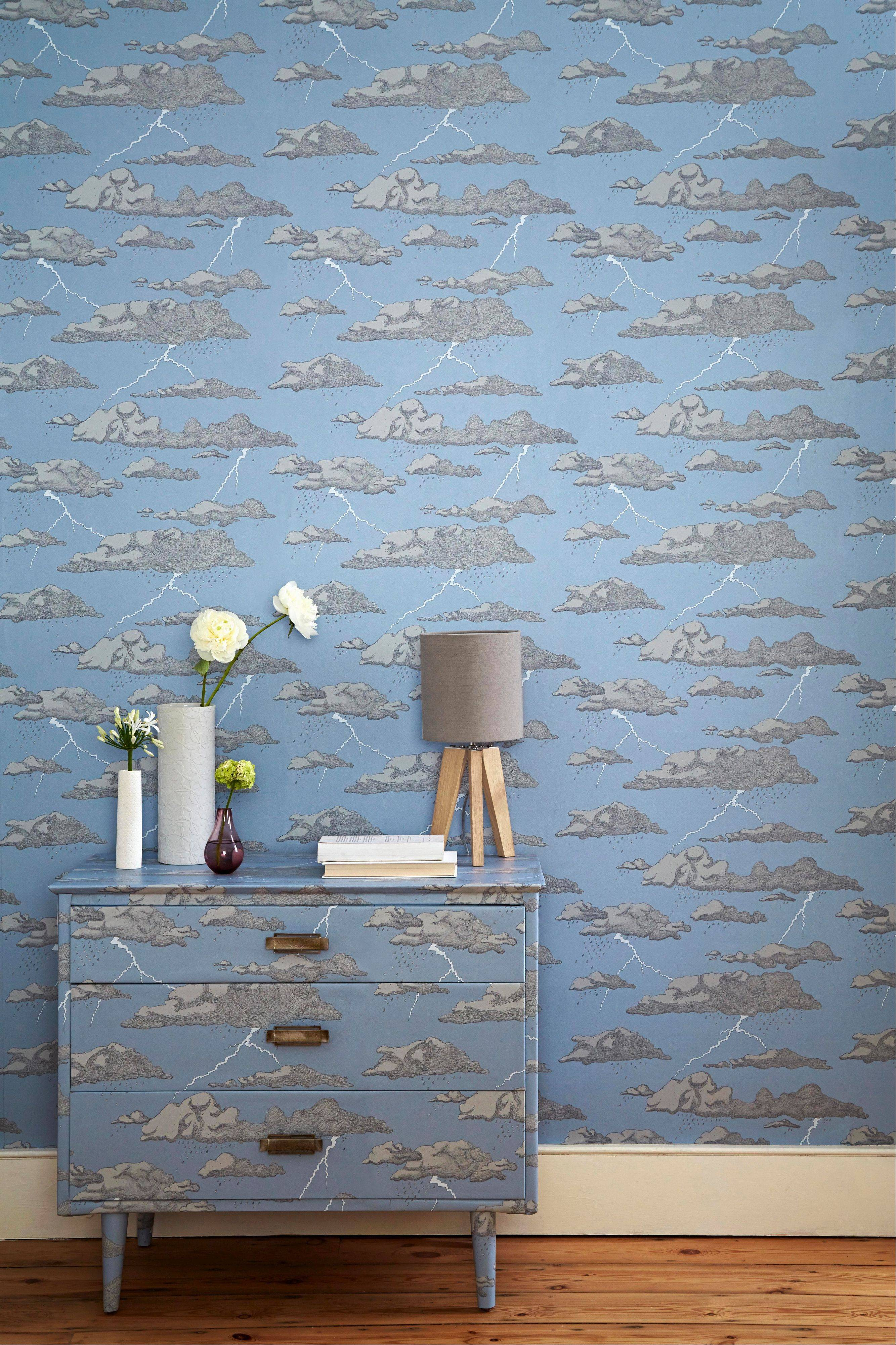 "Designer Abigail Edwards evokes nature in startling and interesting ways in her wallpaper, ""Storm Clouds."" Its available in gray or blue and features metallic lightning bolts."