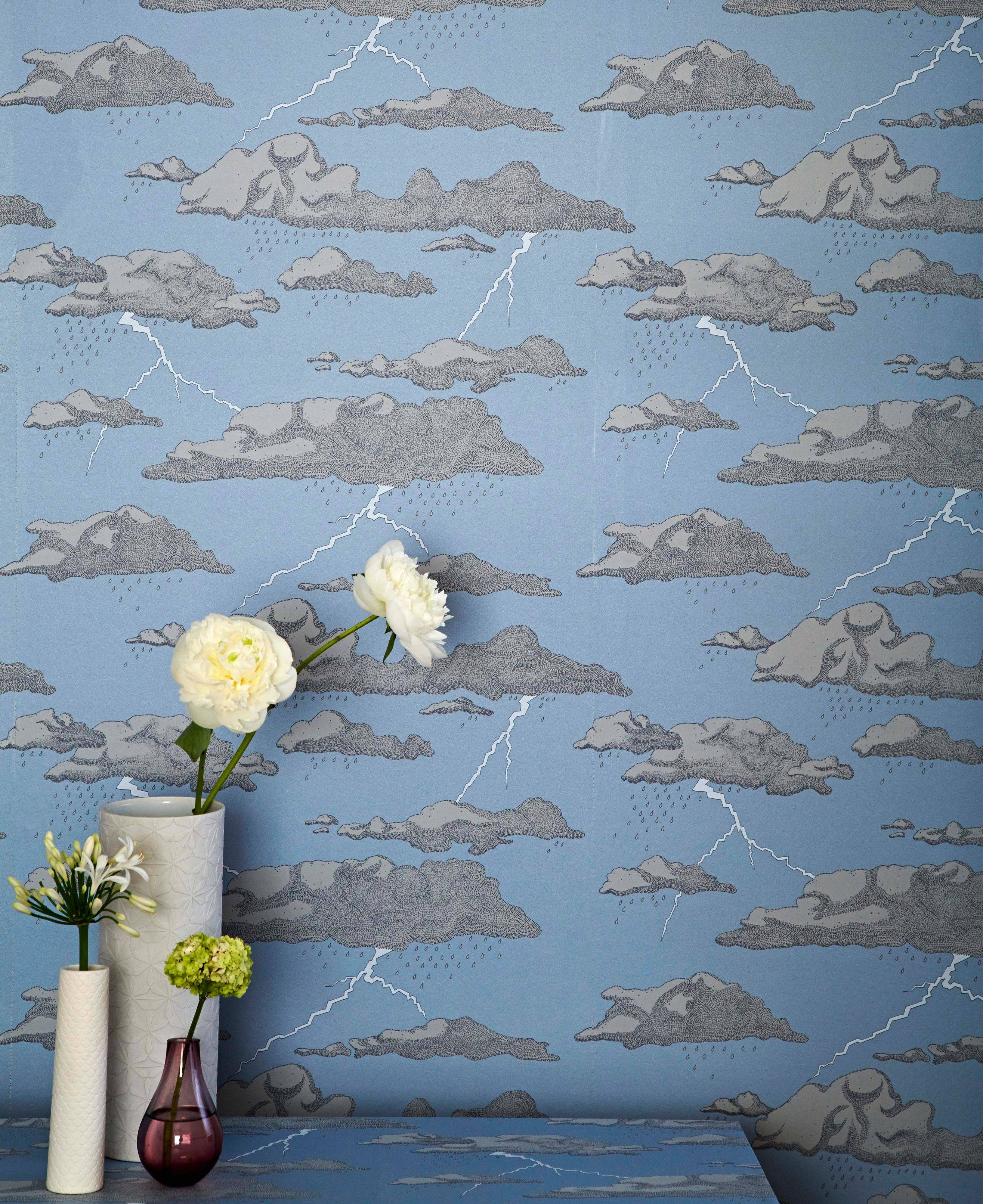 """Storm Clouds,"" a wallpaper designed by Abigail Edwards, is available in gray or blue and features metallic lightning bolts."