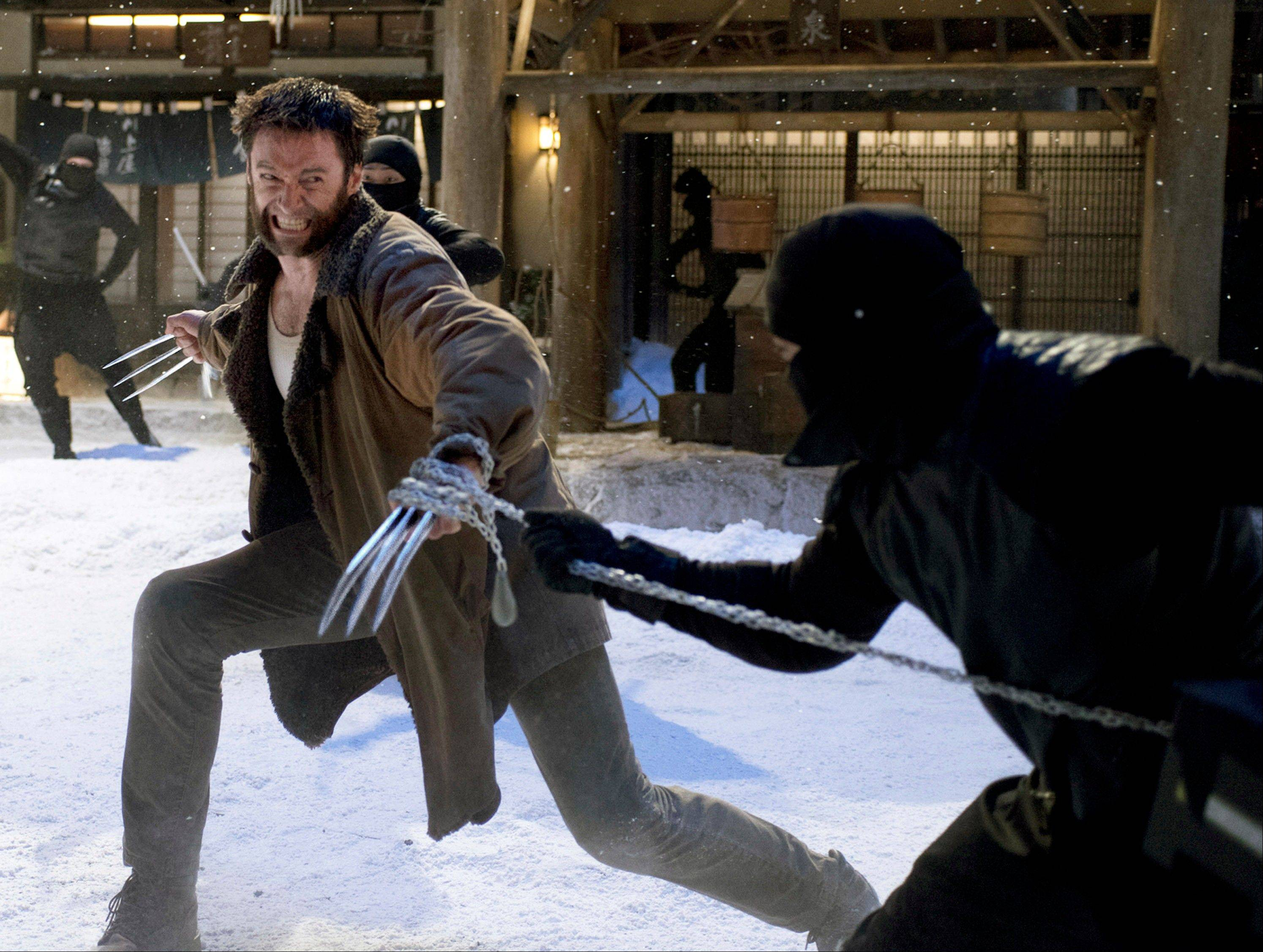"This publicity image released by 20th Century Fox shows Hugh Jackman in a scene from ""The Wolverine."" The superhero film brought in $55 million its first weekend of release."