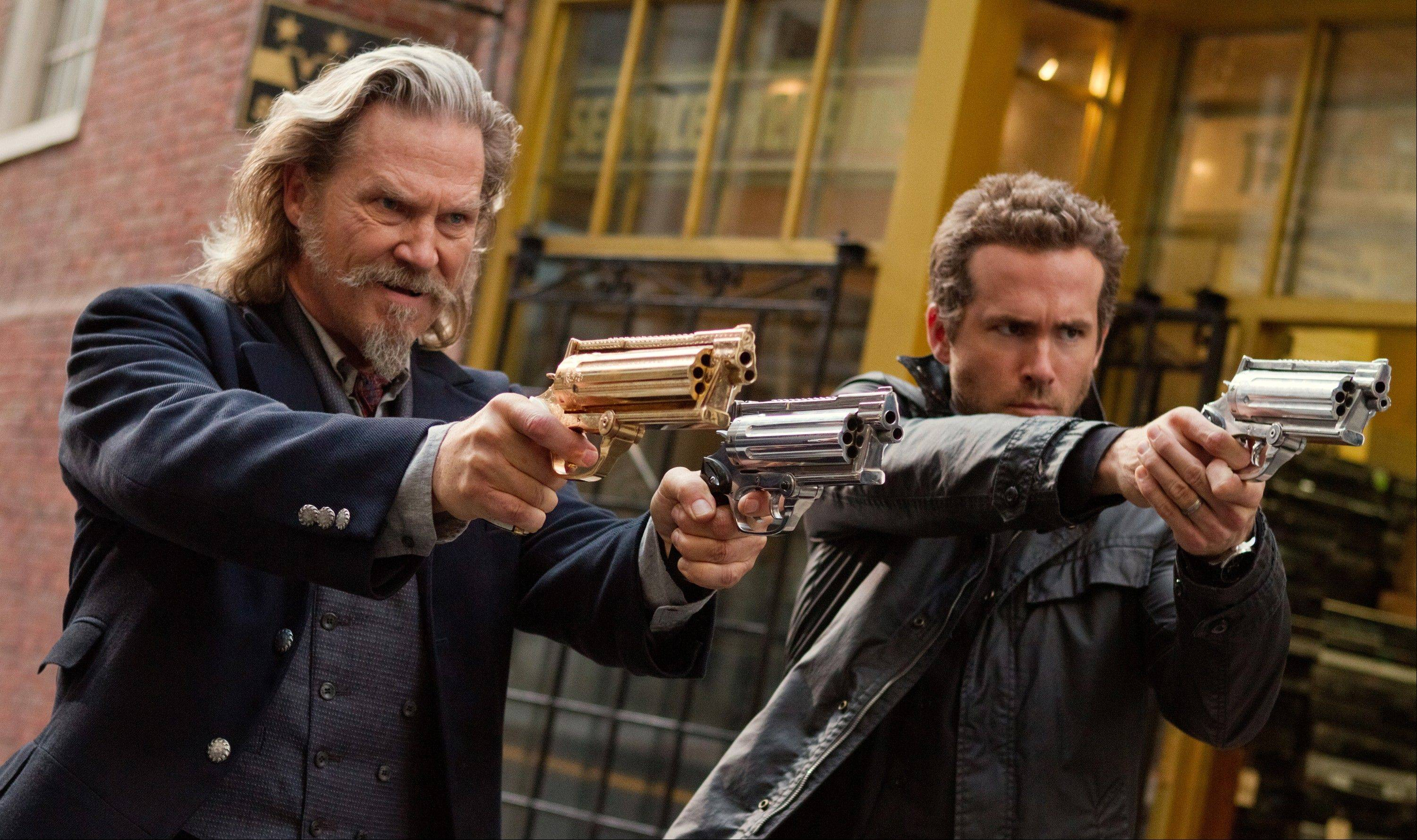 "Jeff Bridges, left, and Ryan Reynolds star ""R.I.P.D.,"" which opened last weekend to dismal reviews and low tickets sales."
