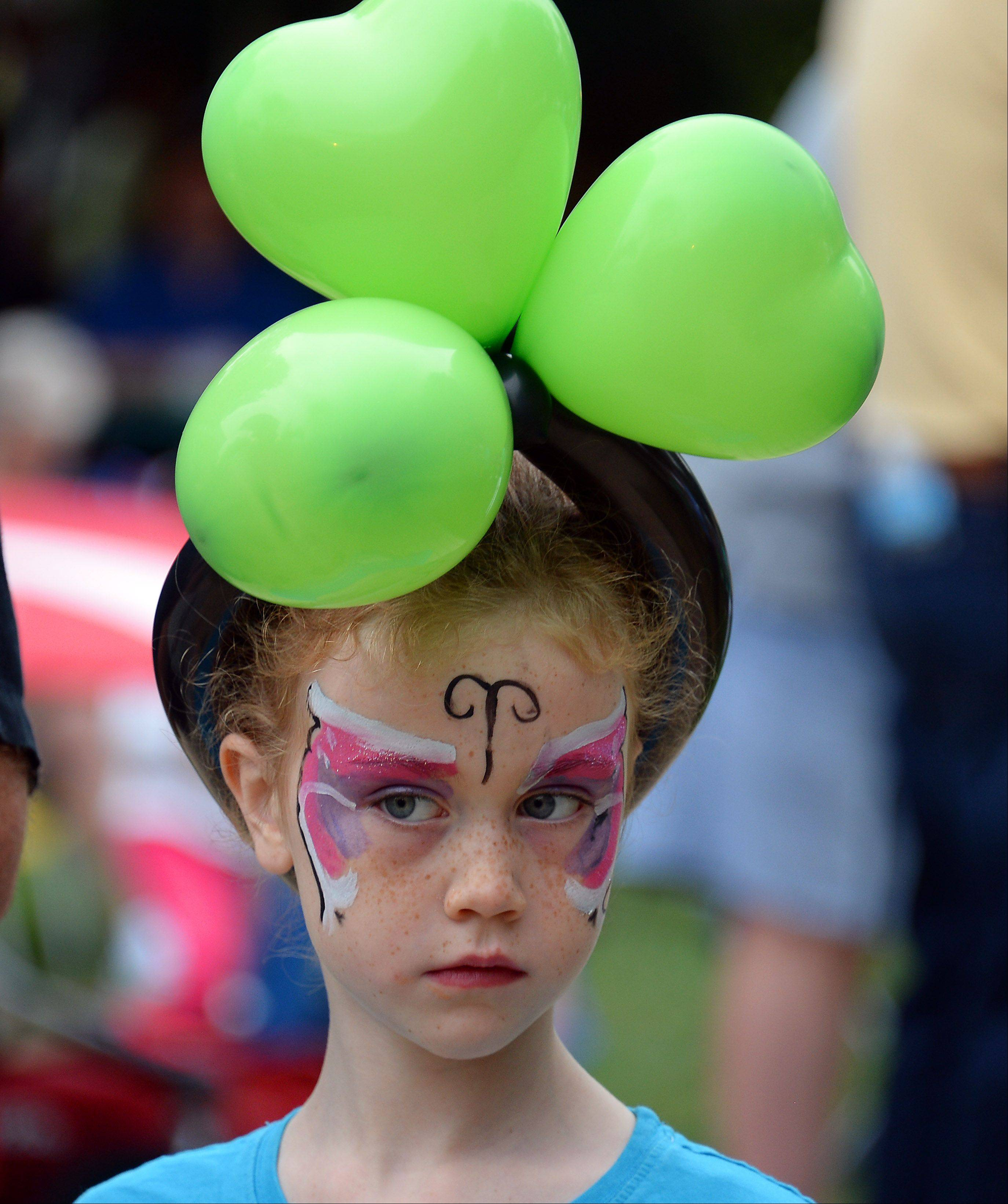 Maddie Scott, 7 , of Arlington Heights wear her special Irish balloon hat at the annual Irish Fest in Arlington Heights on Friday.
