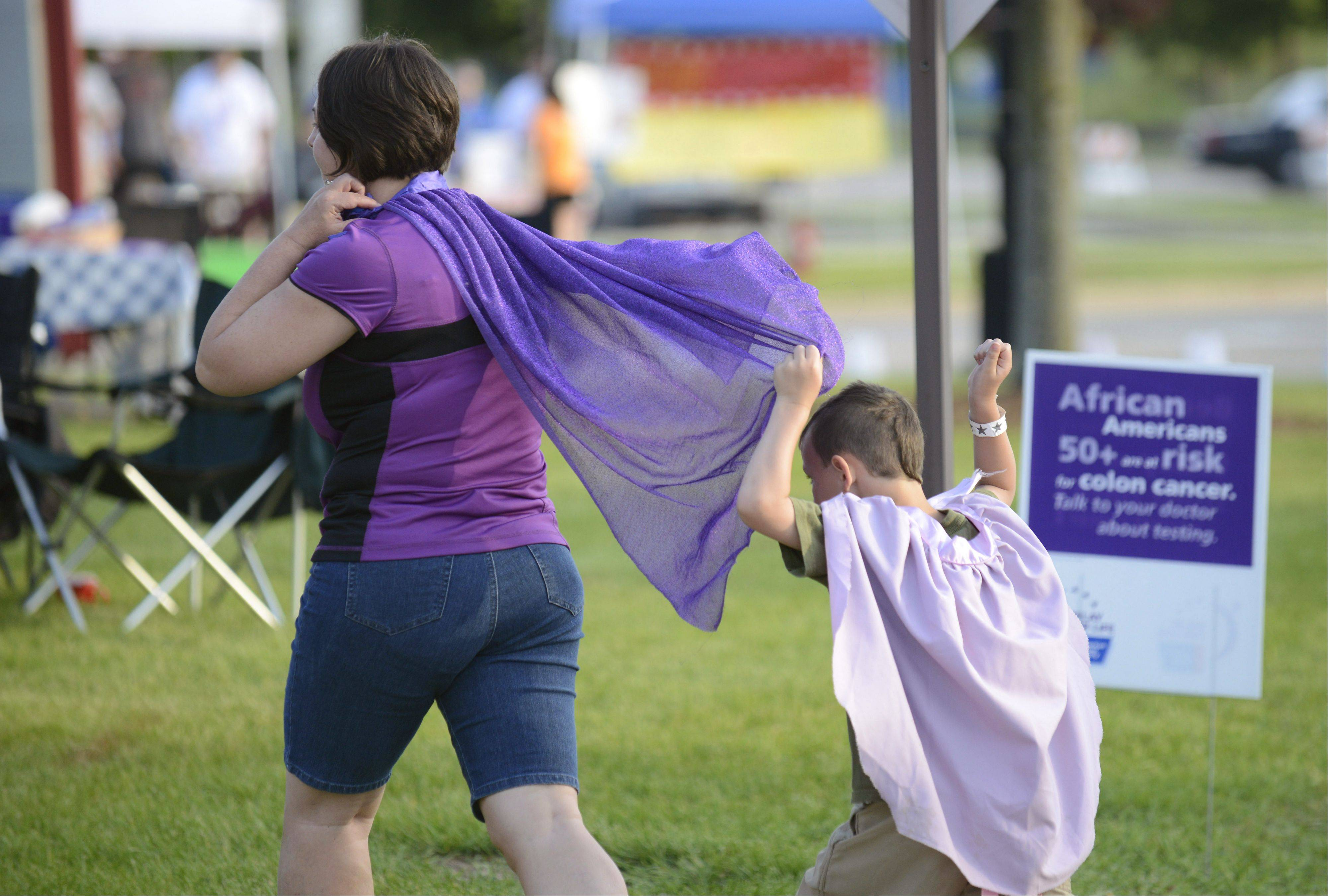 Hiding under Jennifer McClure's cape, is her son Aidan, 5, as they head back to their campsite at Elgin Community College's Relay for Life event in June. The McClure family, of South Elgin, all donned capes for the event, which they have participated in for the past five years. Jennifer lost her aunt to lung cancer. Relay for Life events bring me to tears every time I cover them, as cancer has affected my family as well. So this little moment brought me a smile and helped lighten my heart for a few seconds. The photo was published in the weekly Perspective column.