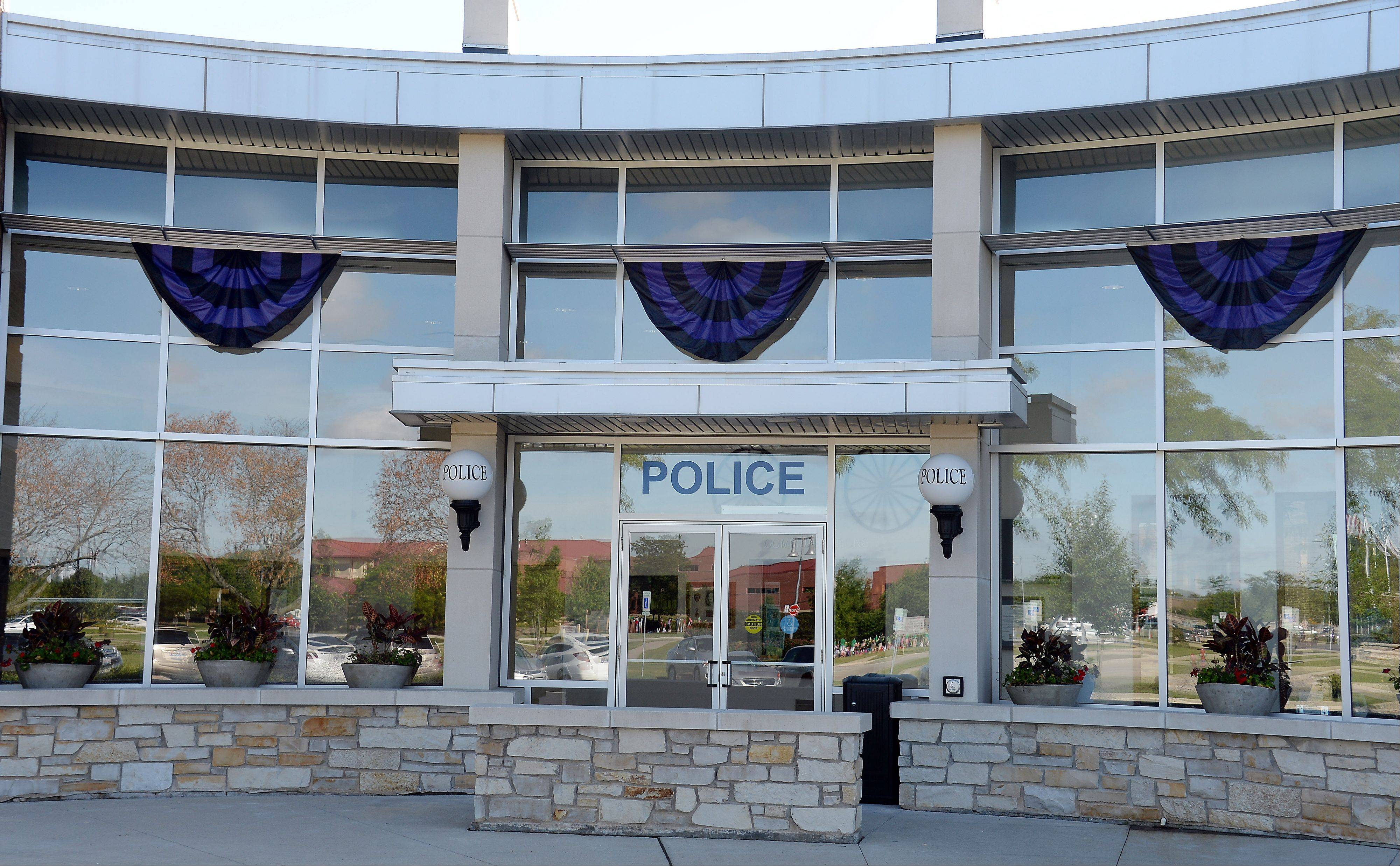 Purple and black bunting hang from the facade at the Wheeling Police Department on Monday to honor Officer Shamekia Goodwin-Badger, who died Saturday after collapsing during a training exercise Thursday.