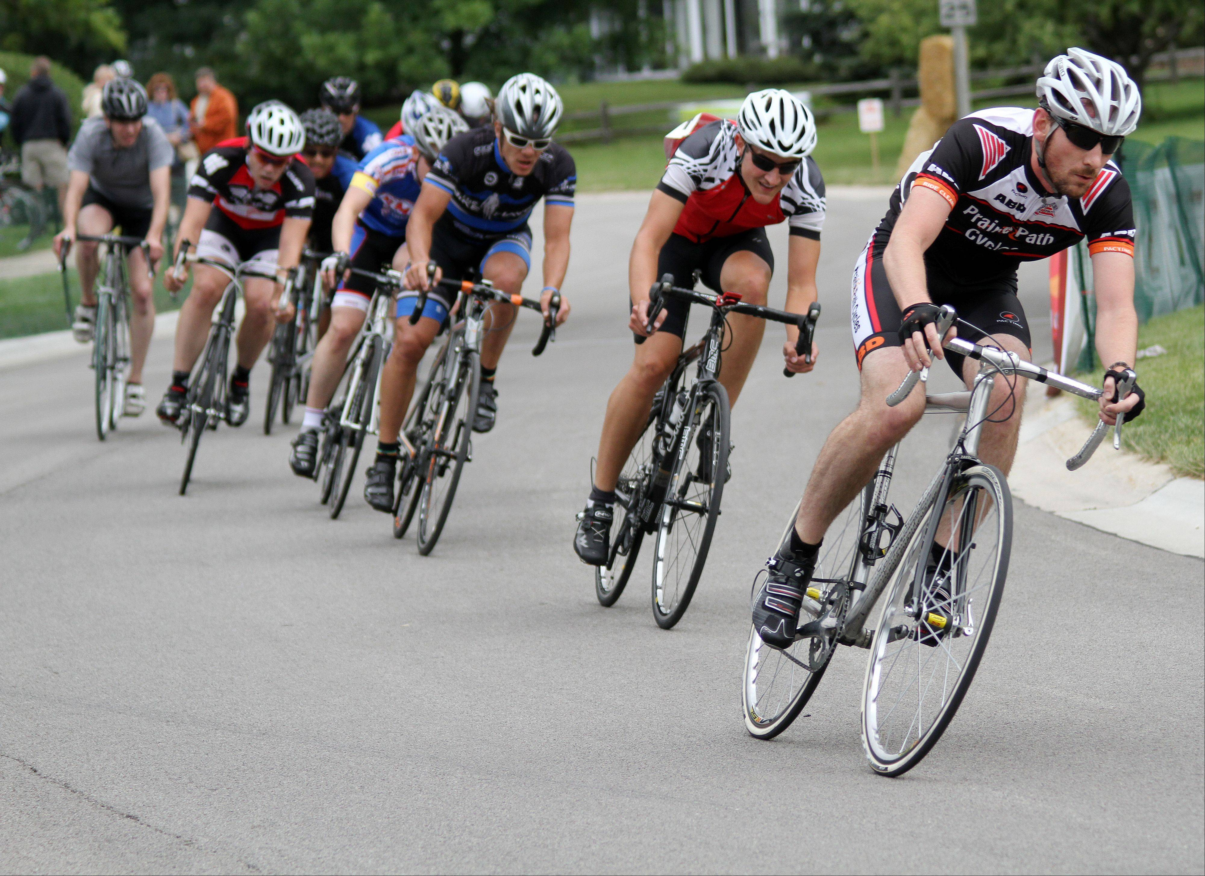 Riders in the Category 5 race round a corner Sunday at the 2013 Winfield Criterium at Oakwood Park. More than 300 races competed in races at the annual event this year.