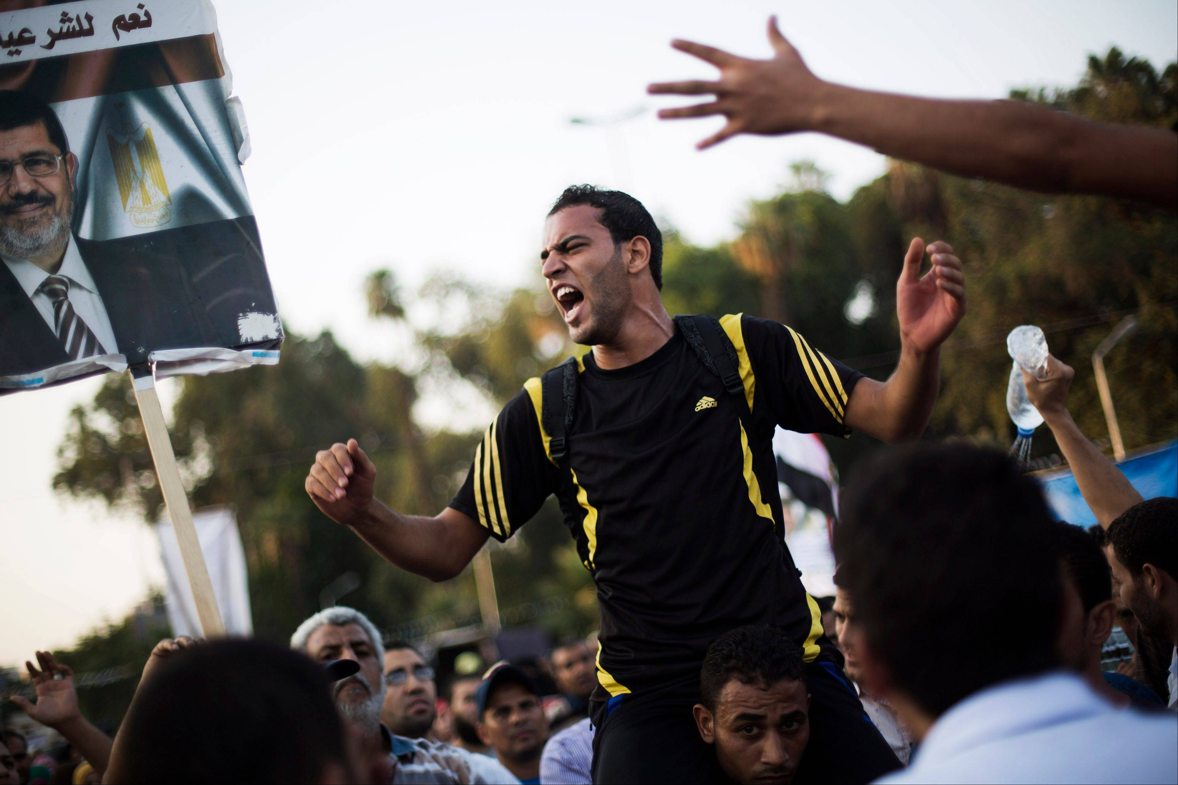 Supporters of Egypt's ousted President Mohammed Morsi chant slogans supporting the former leader during a protest near Cairo University in Giza, Egypt, Sunday.