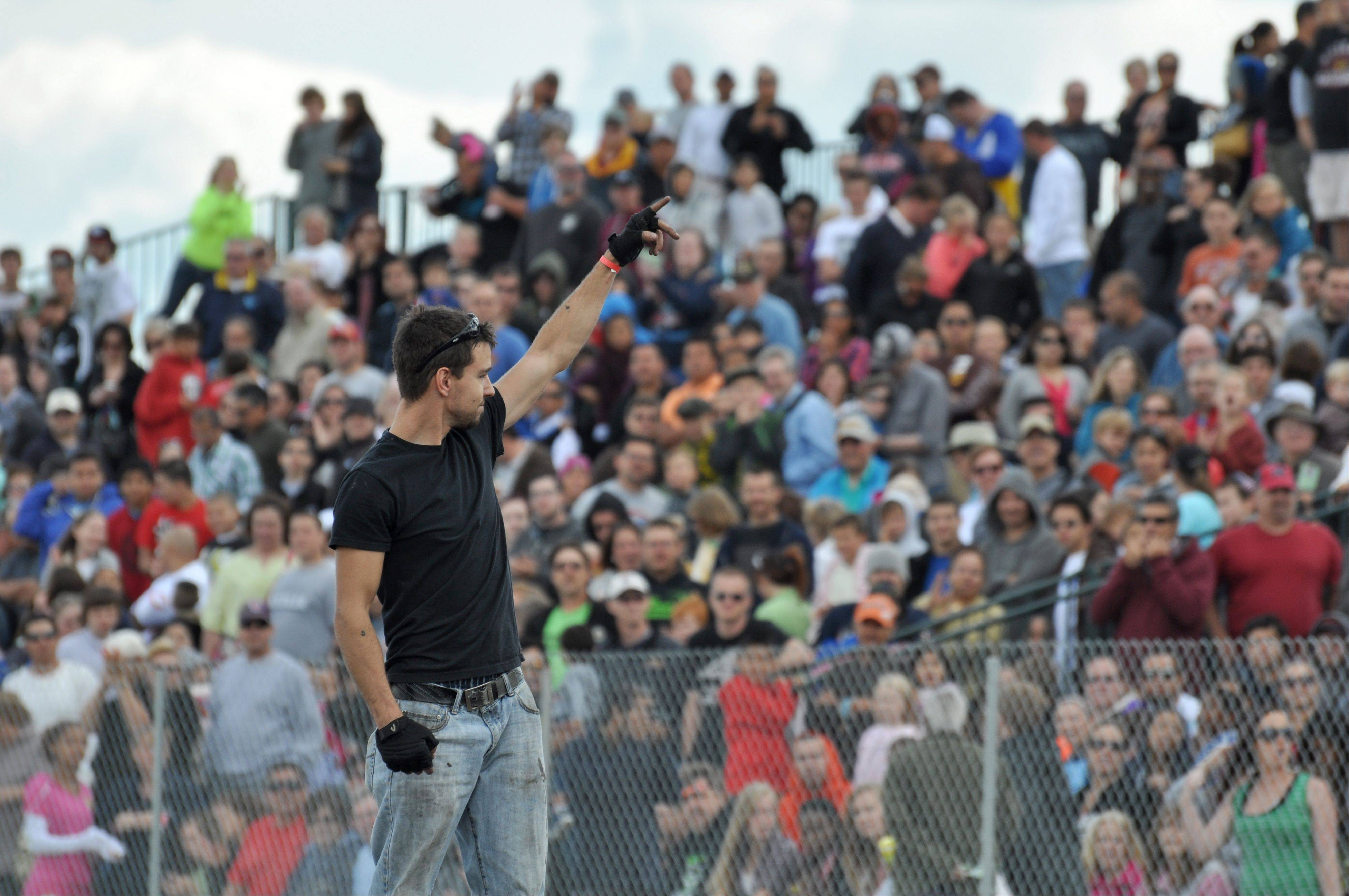 Chris Kniaz, of Des Plaines, draws applause from the crowd during the Destruction Derby at the Lake County Fair Sunday, July 28. Although Kniaz lost the derby he was awarded most aggressive driver and was a crowd favorite.