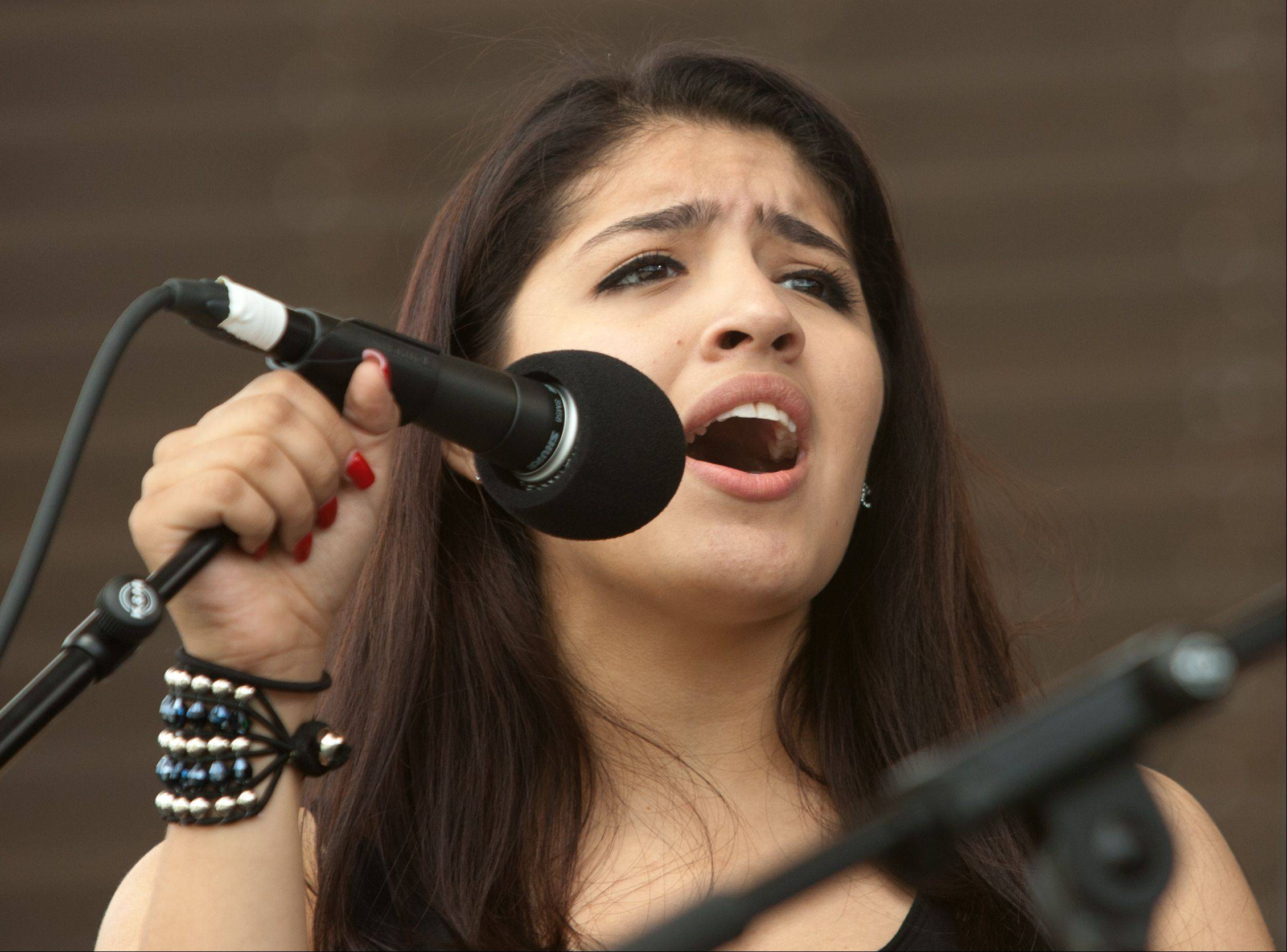 Vocalist Julissa Chapa sings during the Puerto Rican Heritage Fest at RiverEdge Park in Aurora. Chapa sings in the Ministerios Adonai DNA of Christ Christian Band.