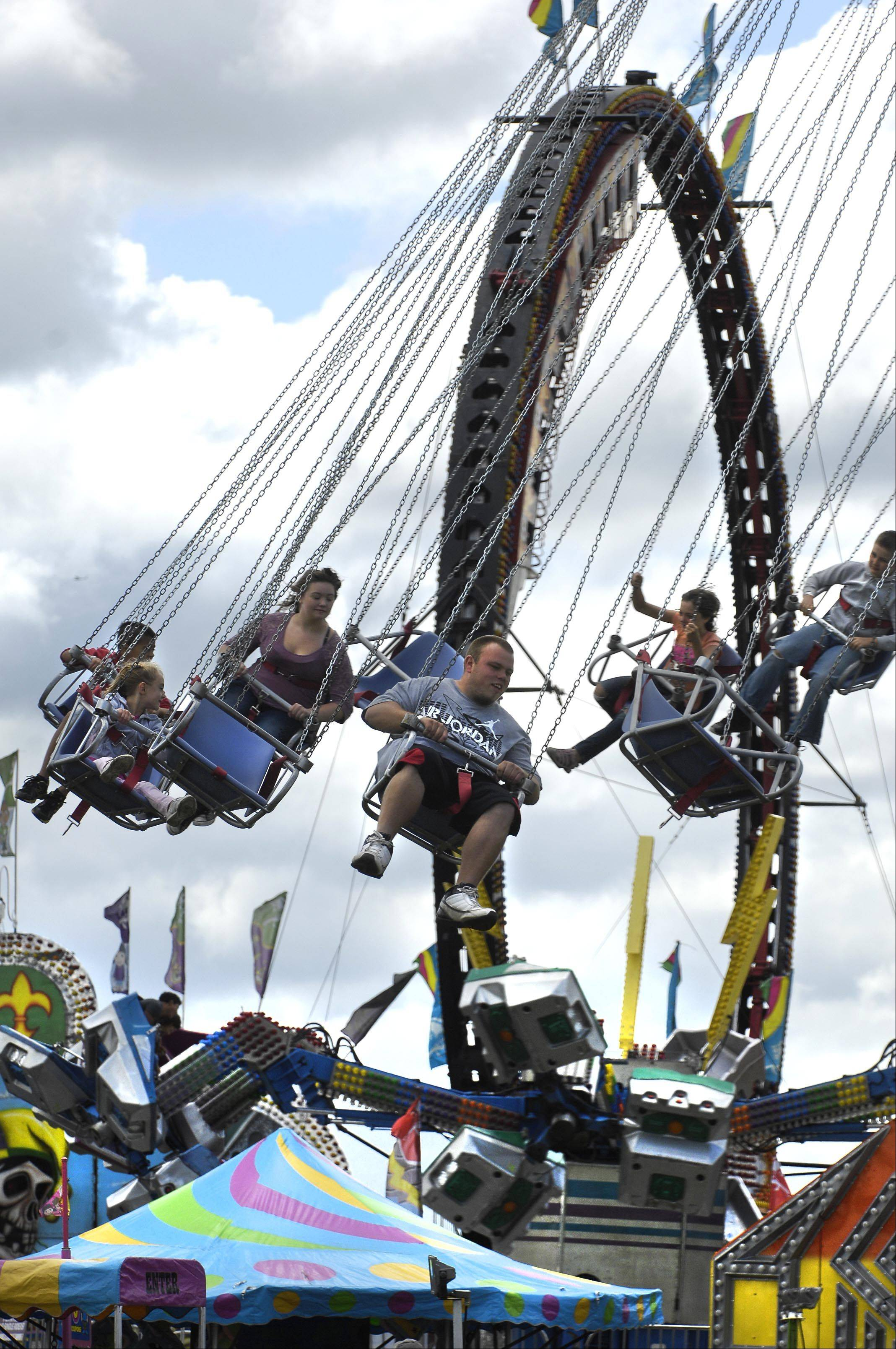 Yo-Yo riders swing above the other rides except the Ring of Fire at the final day of the Algonquin Founders Day Festival Sunday in Algonquin Lakes Park.