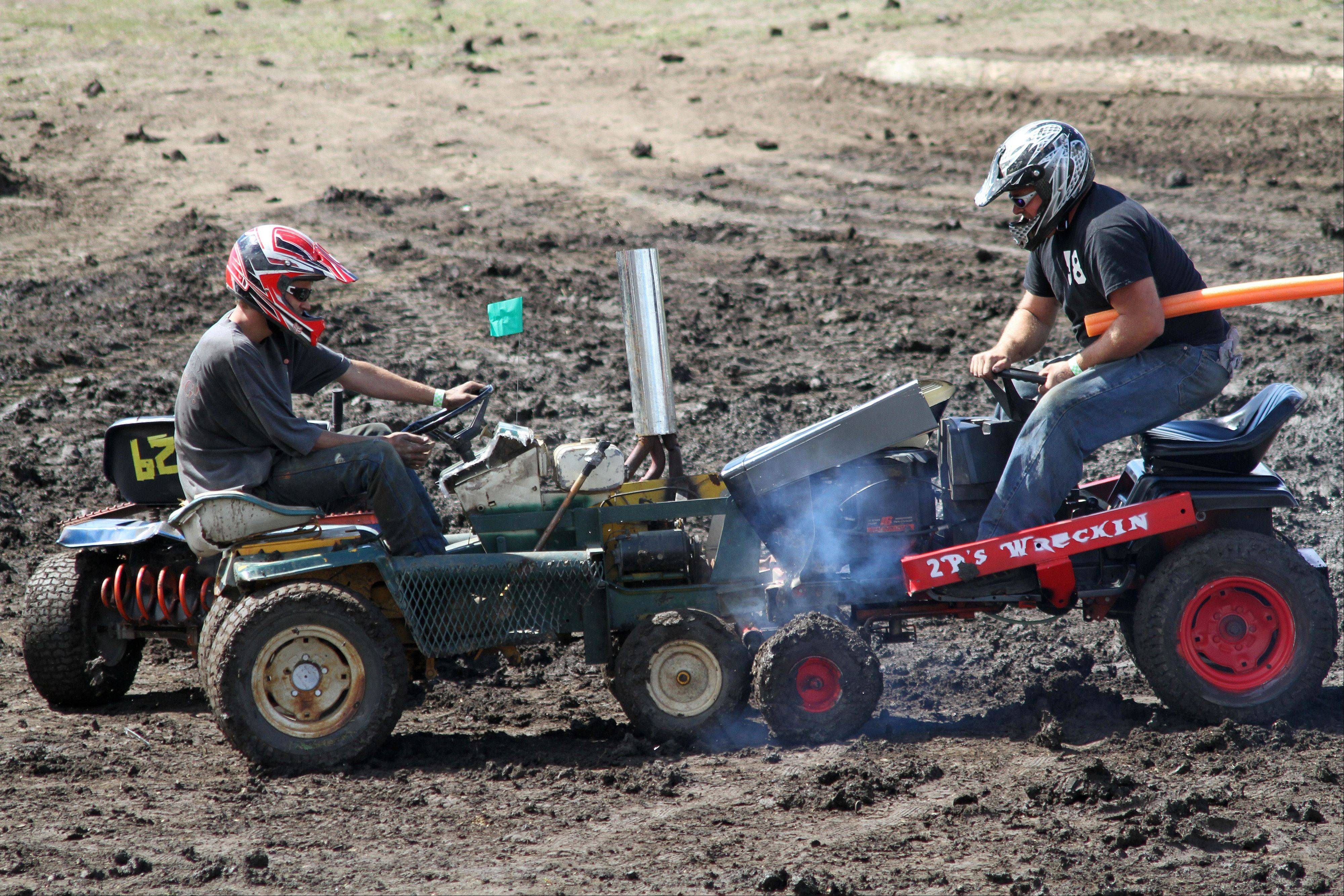 Cody Lang (left) and Brian Elingsworth collide in the lawn mower heat of the demolition derby at the 2013 DuPage County Fair on Sunday, July 28, 2013. The lawn mower heat was a new addition.