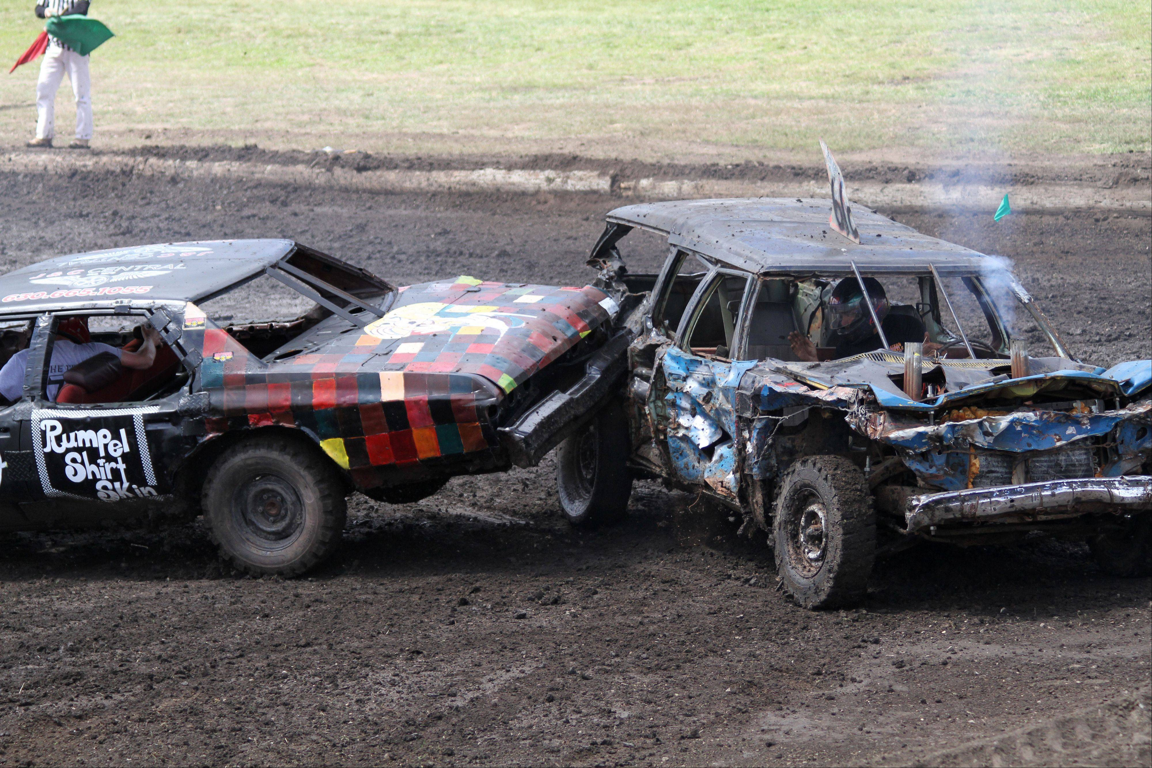 Two cars collide at the demolition derby at the 2013 DuPage County Fair on Sunday, July 28, 2013.