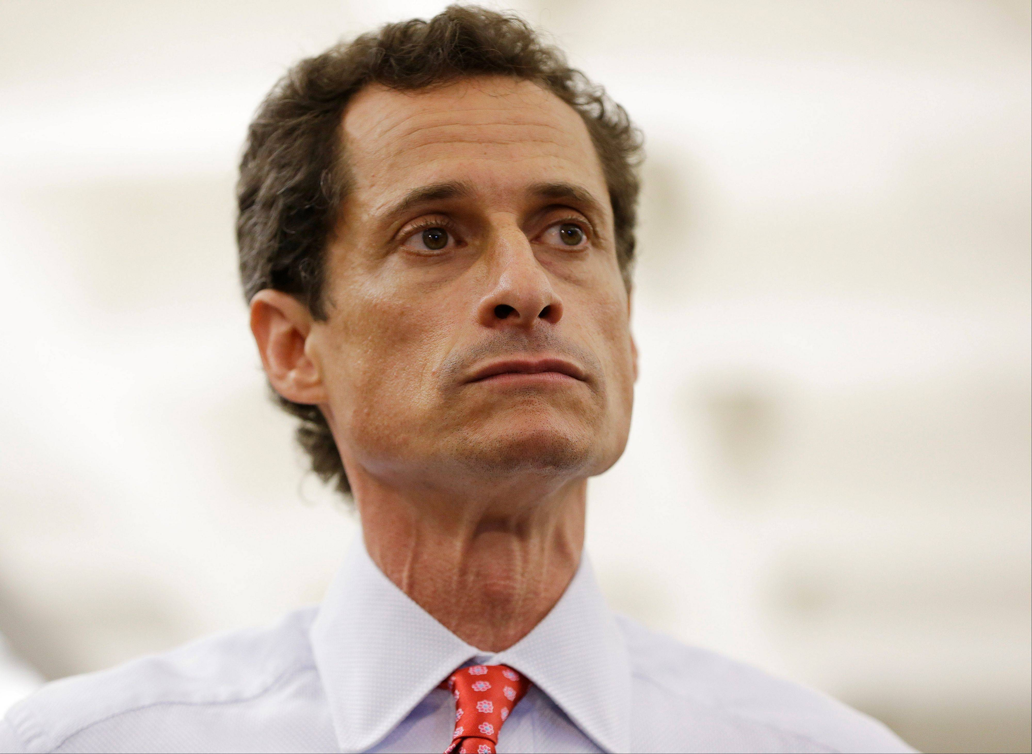 New York City Mayoral candidate Anthony Weiner takes reporters questions Tuesday during a news conference at the Gay Men's Health Crisis headquarters in New York. The former congressman says he's not dropping out of the New York City mayoral race in light of newly revealed explicit online correspondence with a young woman.