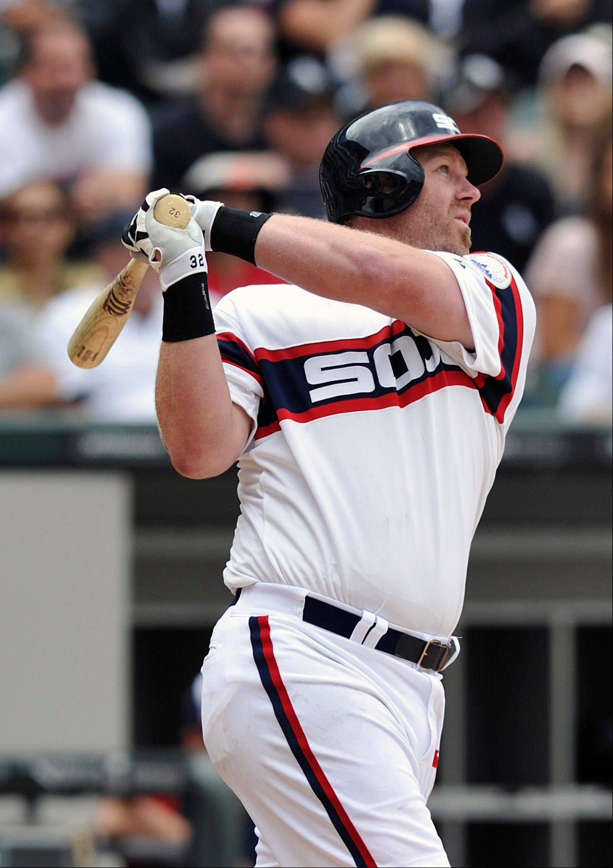 Adam Dunn watches his solo home run against the Royals during the sixth inning of the Sox' loss Sunday at U.S. Cellular Field.